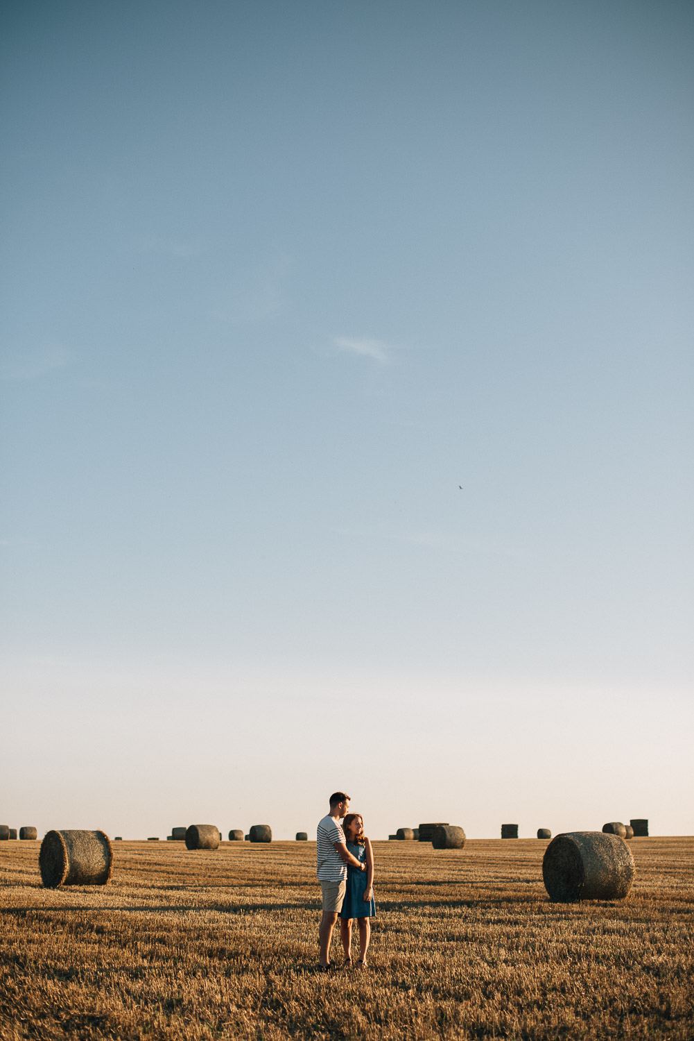 couple in golden field for engagement shoot by alternative london wedding photographer the shannons photography