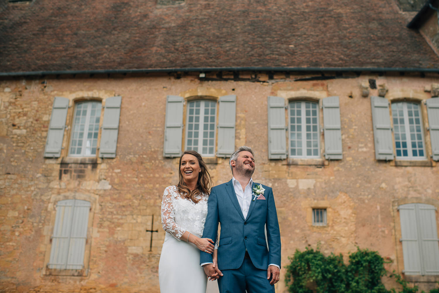 Bride in Rime Arodaky wedding dress in front of chateau de la bourlie wedding by destination wedding photographer the shannons photography