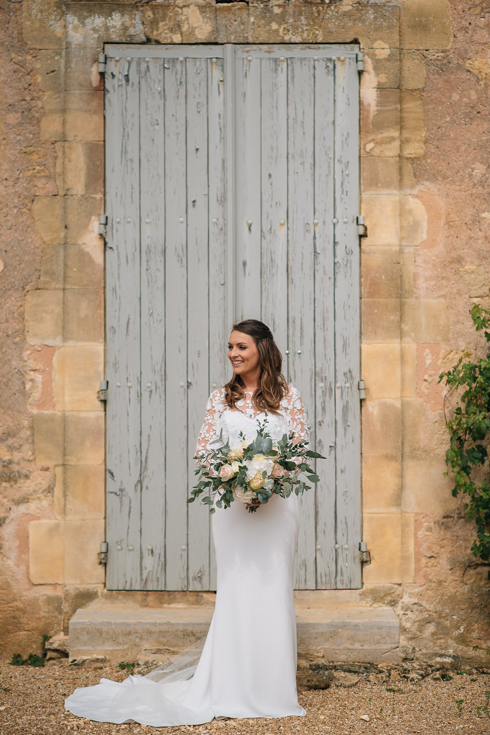 Bride and french shutters in chateau de la bourlie wedding by french destination wedding photographer the shannons photography