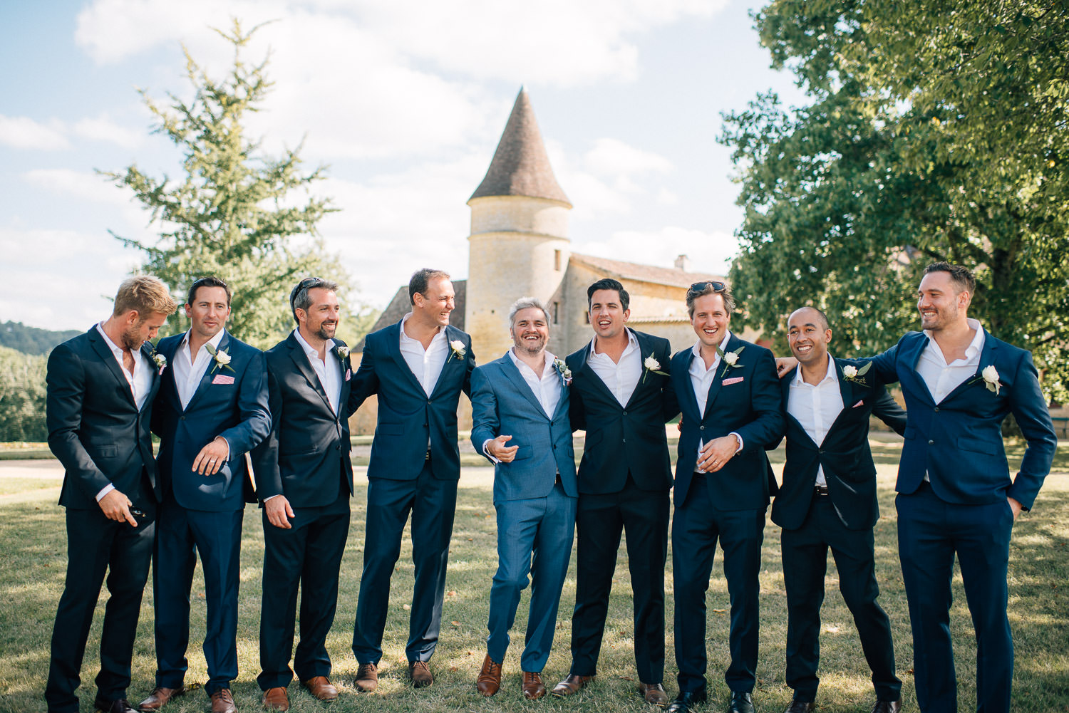 Groomsmen in hugo boss suits in chateau de la bourlie wedding by french destination wedding photographer the shannons photography