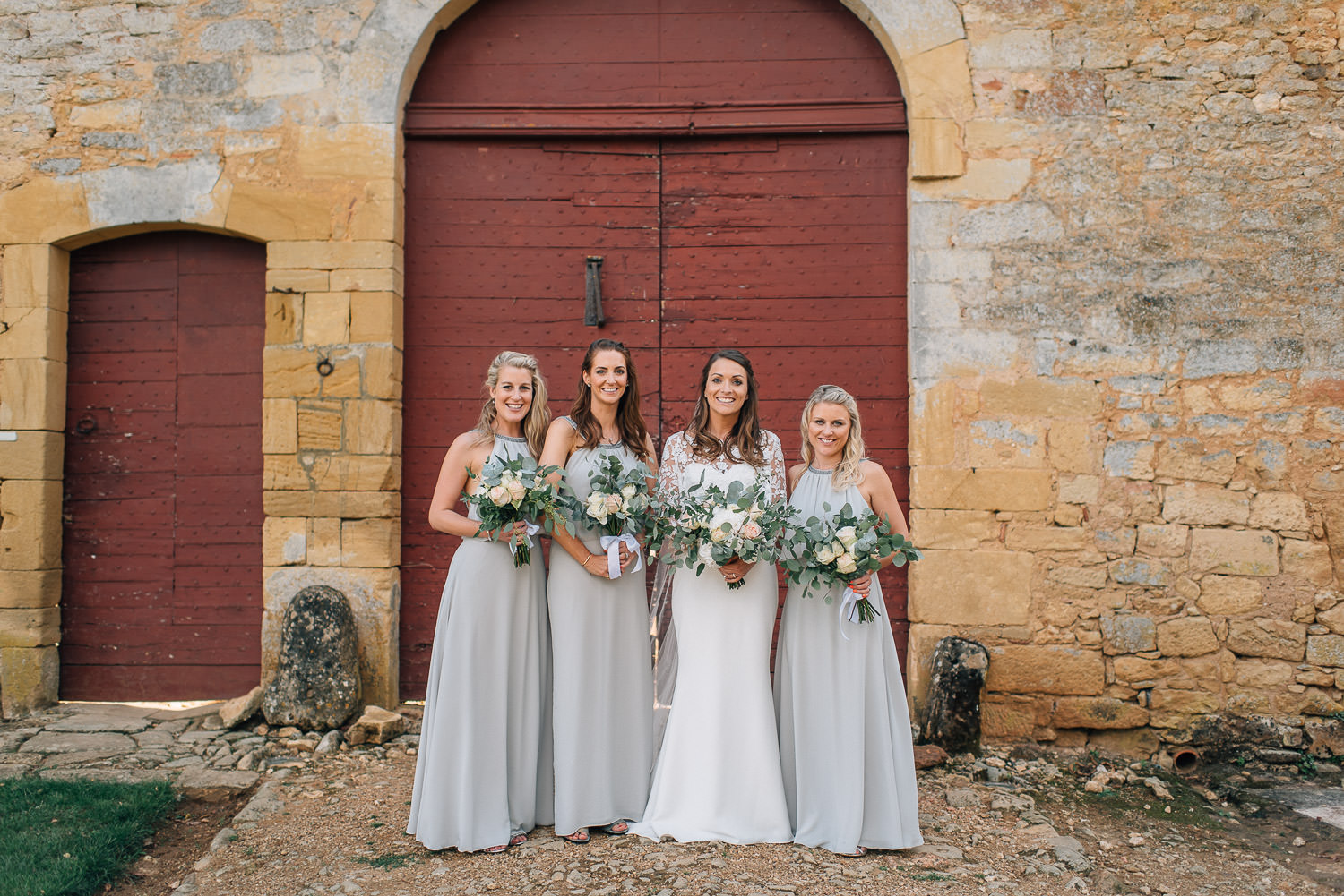 Bridesmaids with Rime Arodaky wedding dress in chateau de la bourlie wedding by destination wedding photographer the shannons photography