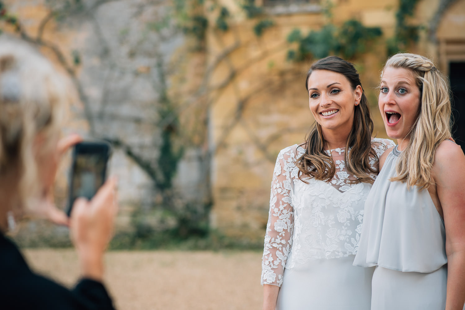 Bride and maid of honour in chateau de la bourlie wedding by french destination wedding photographer the shannons photography