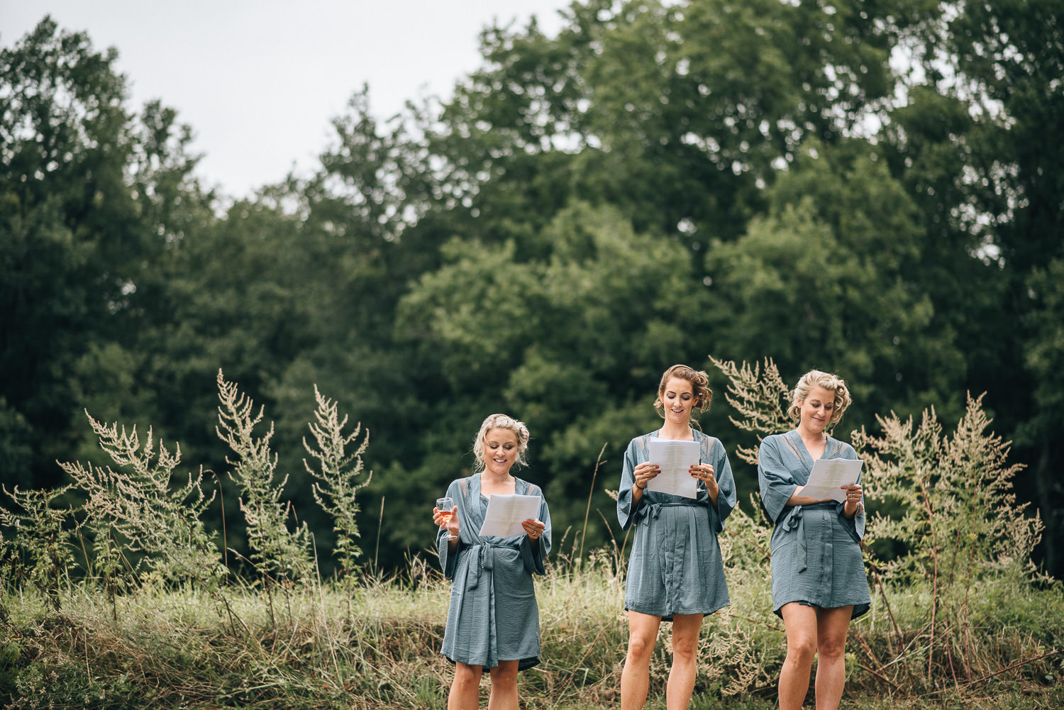 Bridesmaids rehearsing speeches at Chateau de la Bourlie Wedding by creative and alternative destination wedding photographer the shannons photography