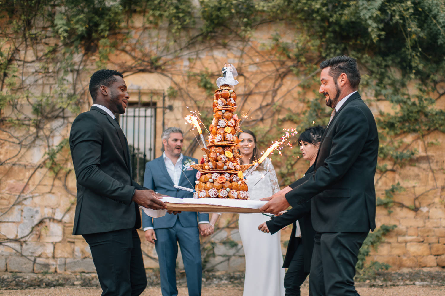 croq en bouche wedding cake in chateau de la bourlie wedding by french destination wedding photographer the shannons photography
