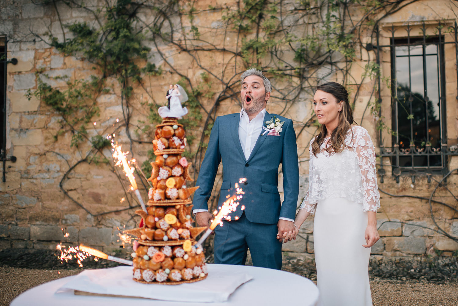 croq en bouche sparkler wedding cake in chateau de la bourlie wedding by french destination wedding photographer the shannons photography