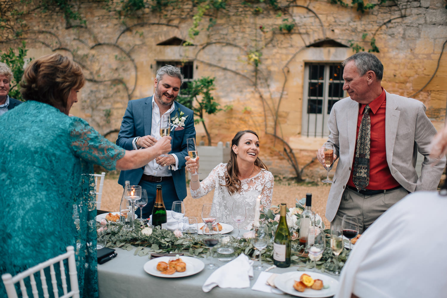 Courtyard wedding in chateau de la bourlie wedding by french destination wedding photographer the shannons photography