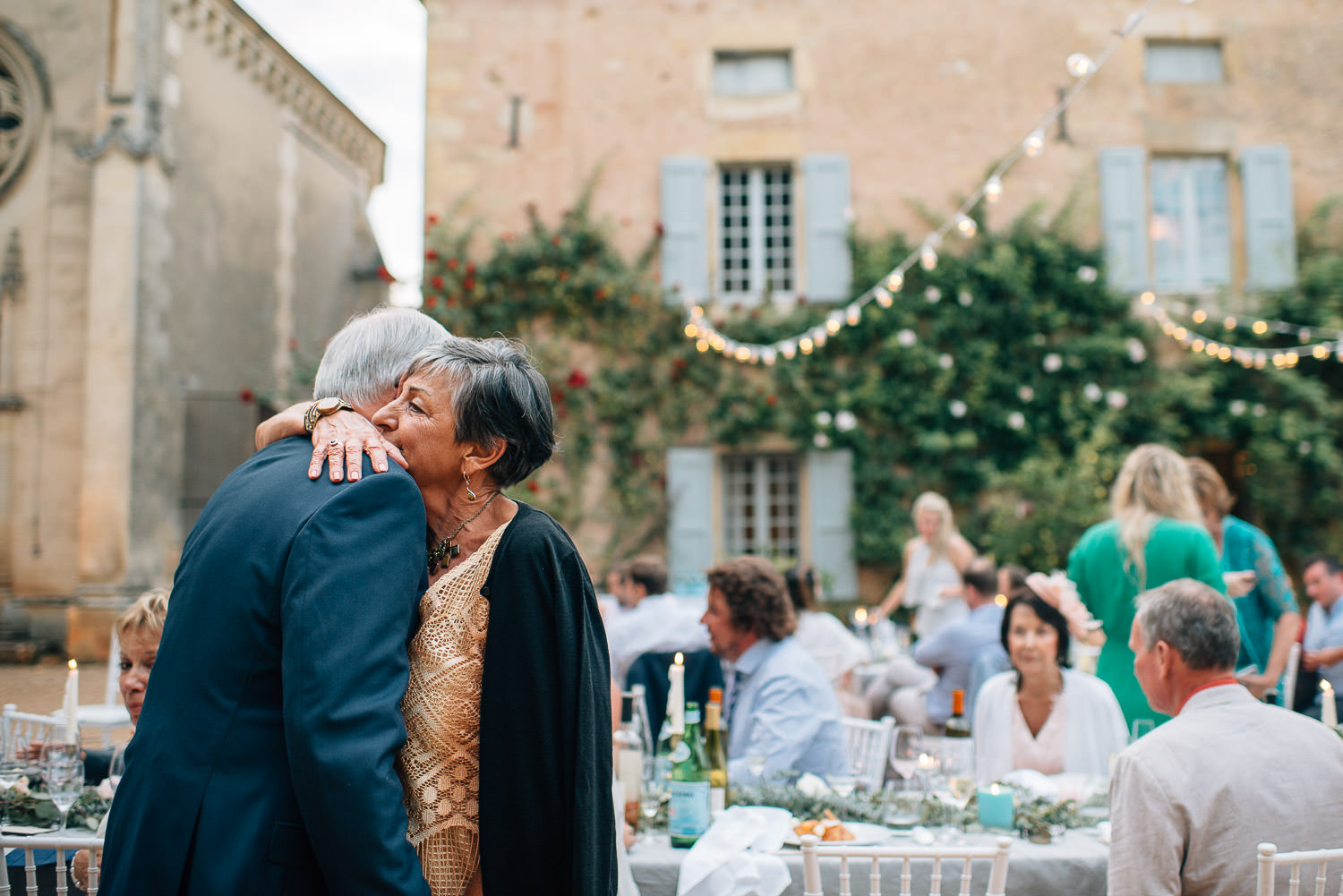 Emotional embrace in chateau de la bourlie wedding by french destination wedding photographer the shannons photography