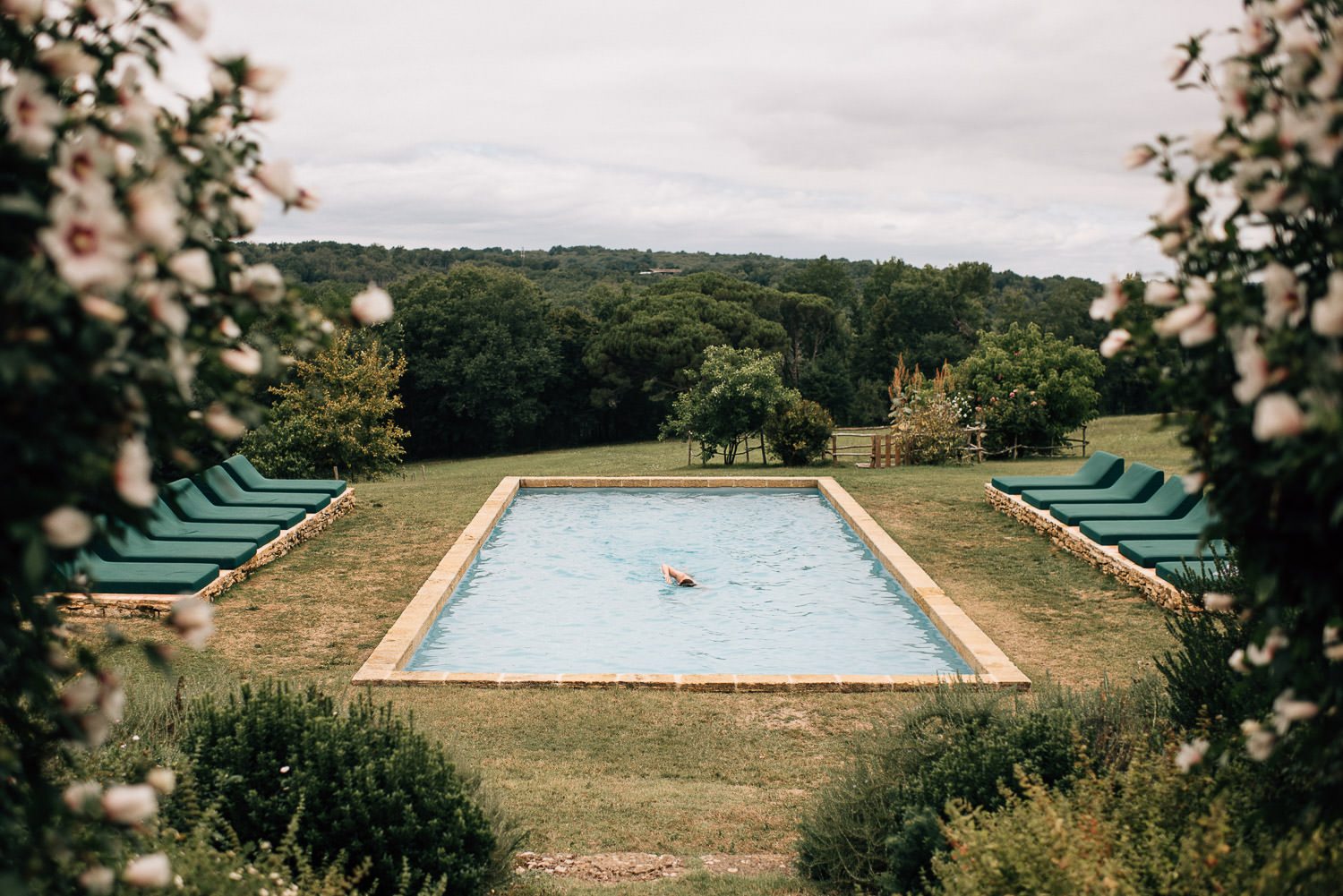 Swimming pool at Chateau de la Bourlie Wedding by creative and alternative destination wedding photographer the shannons photography