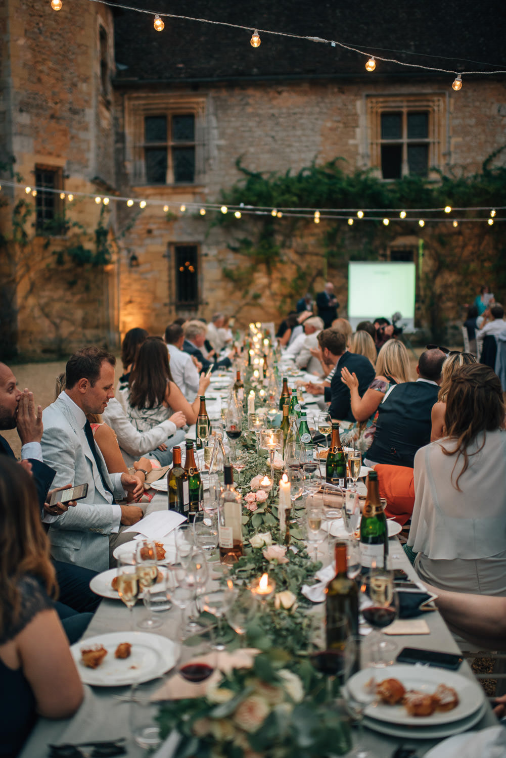 Evening reception in chateau de la bourlie wedding by french destination wedding photographer the shannons photography