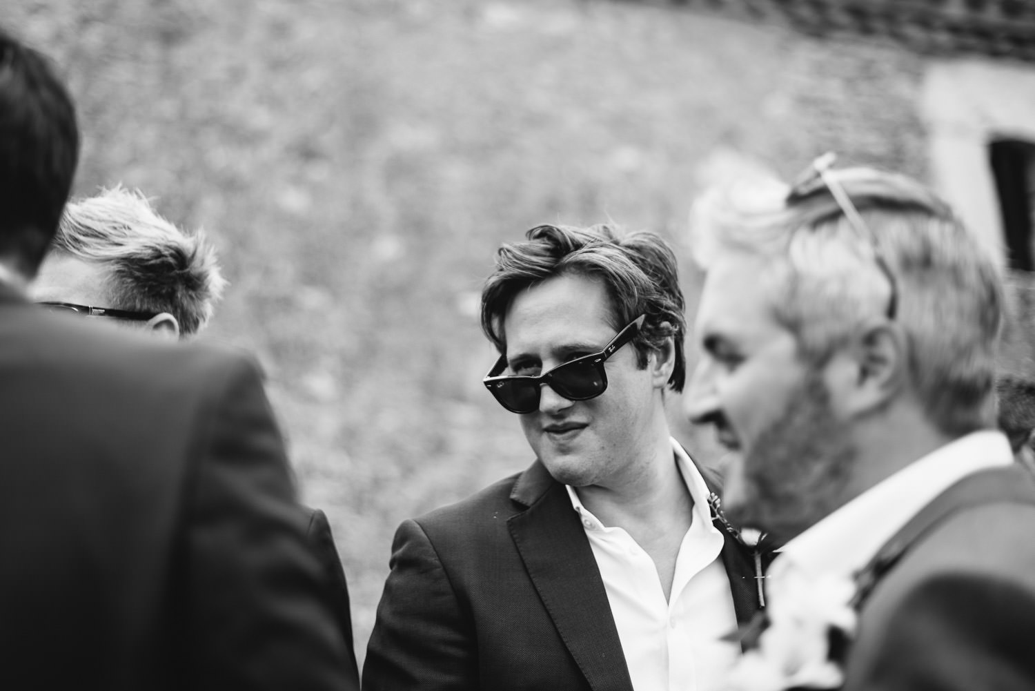 Groomsmen drinking in Chateau de la Bourlie Wedding by creative and alternative destination wedding photographer the shannons photography
