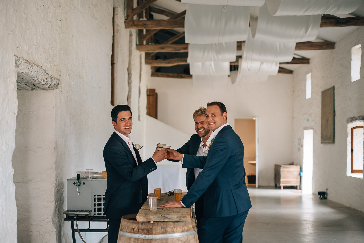 Groomsmen at the bar in Chateau de la Bourlie Wedding by creative and alternative destination wedding photographer the shannons photography