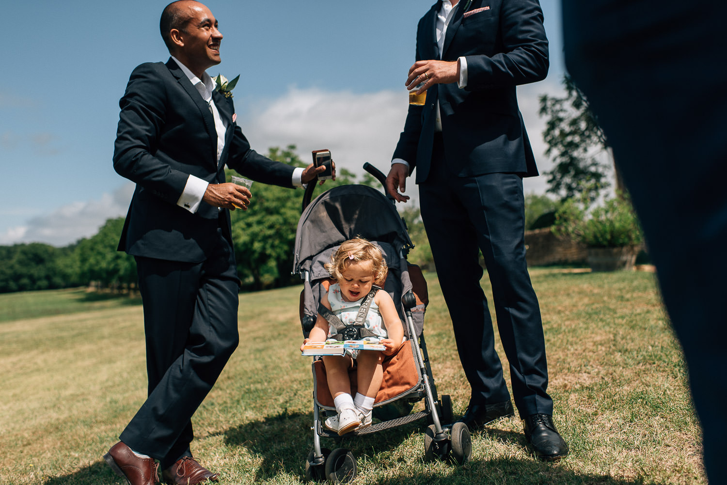 Baby in pram in Chateau de la Bourlie Wedding by creative and alternative destination wedding photographer the shannons photography