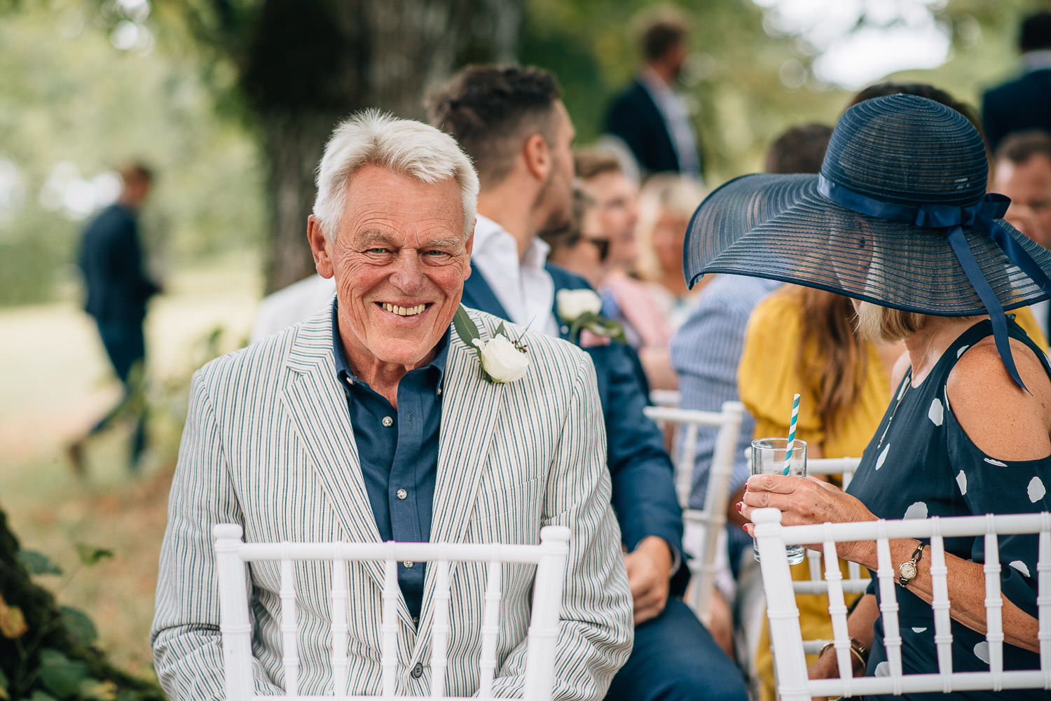 Grandad smiling in chateau de la bourlie wedding by destination wedding photographer the shannons photography