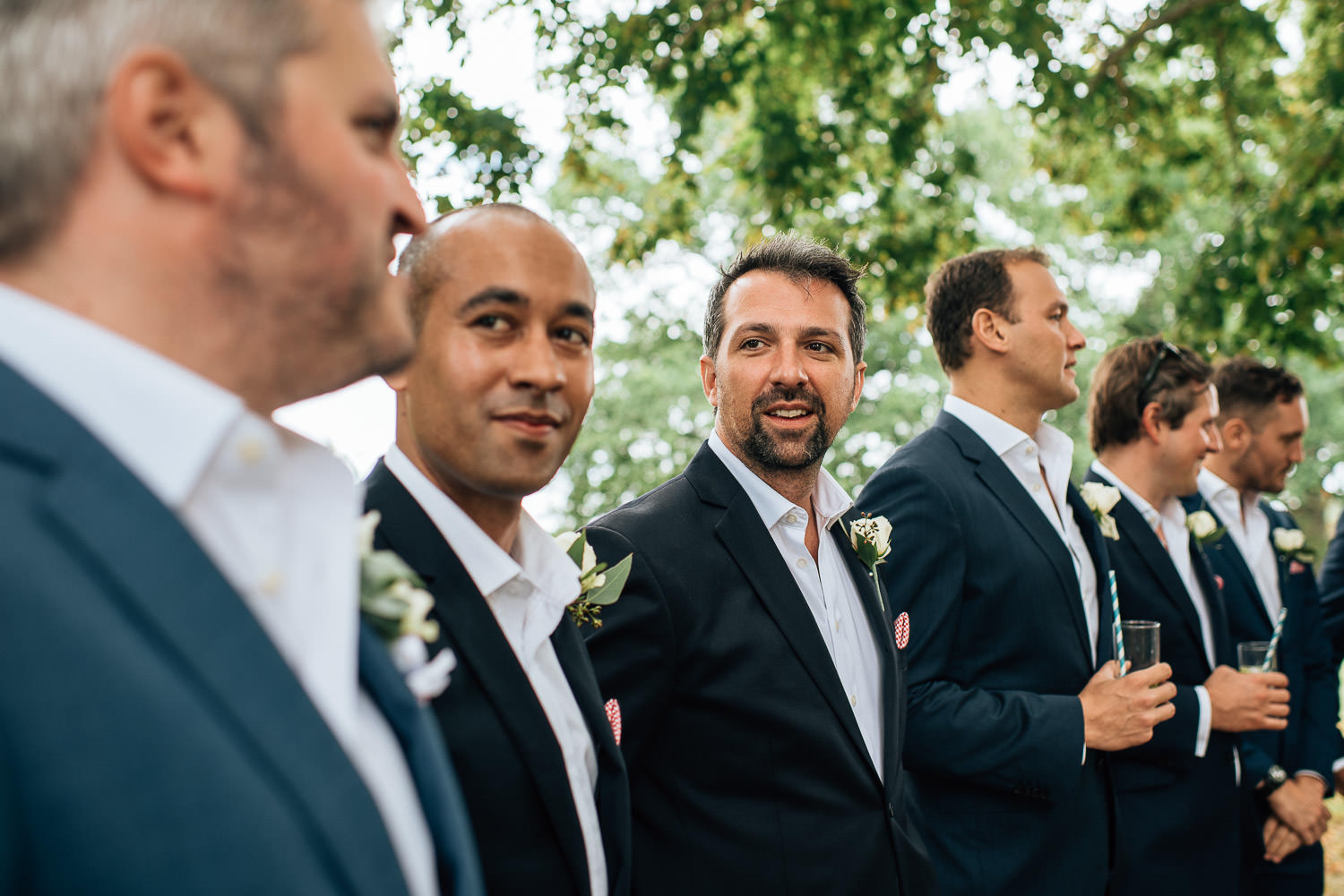 Groom standing ready in chateau de la bourlie wedding by french destination wedding photographer the shannons photography
