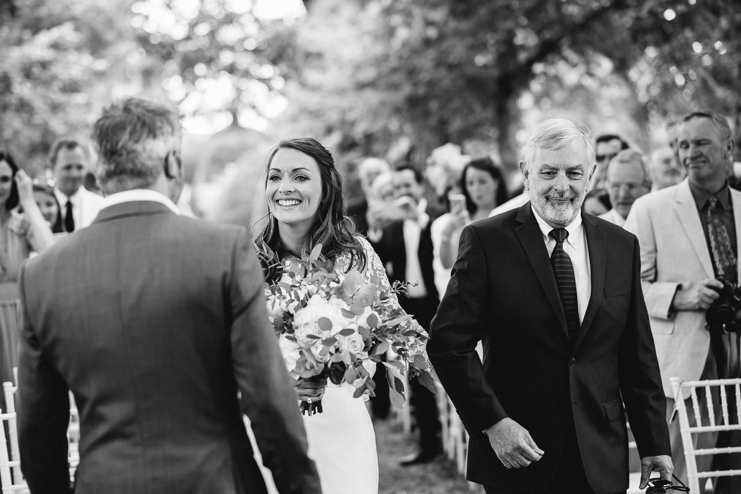 Outdoor wedding ceremony at chateau de la bourlie wedding by destination wedding photographer the shannons photography