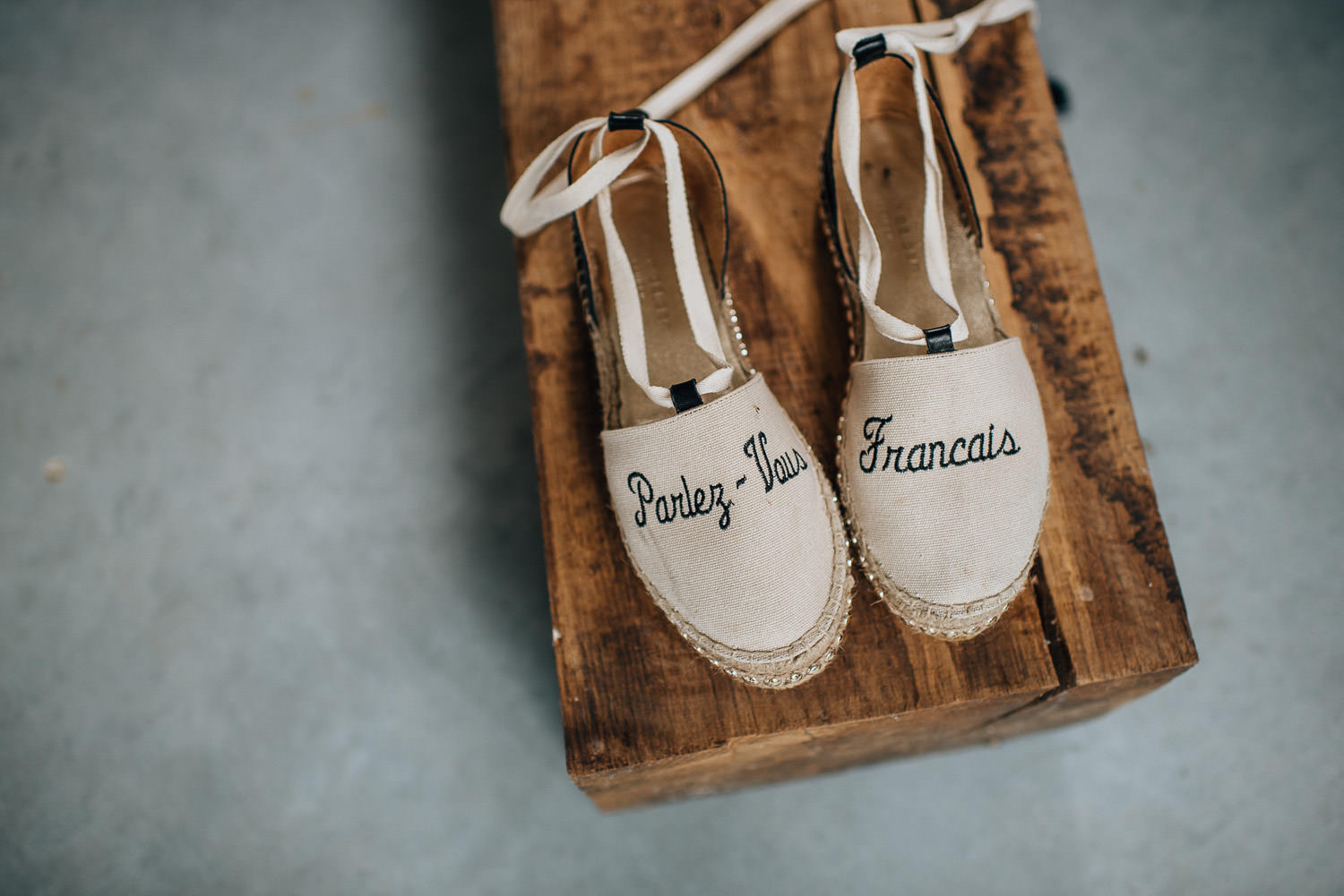 Wedding slippers in Chateau de la Bourlie Wedding by creative and alternative destination wedding photographer the shannons photography