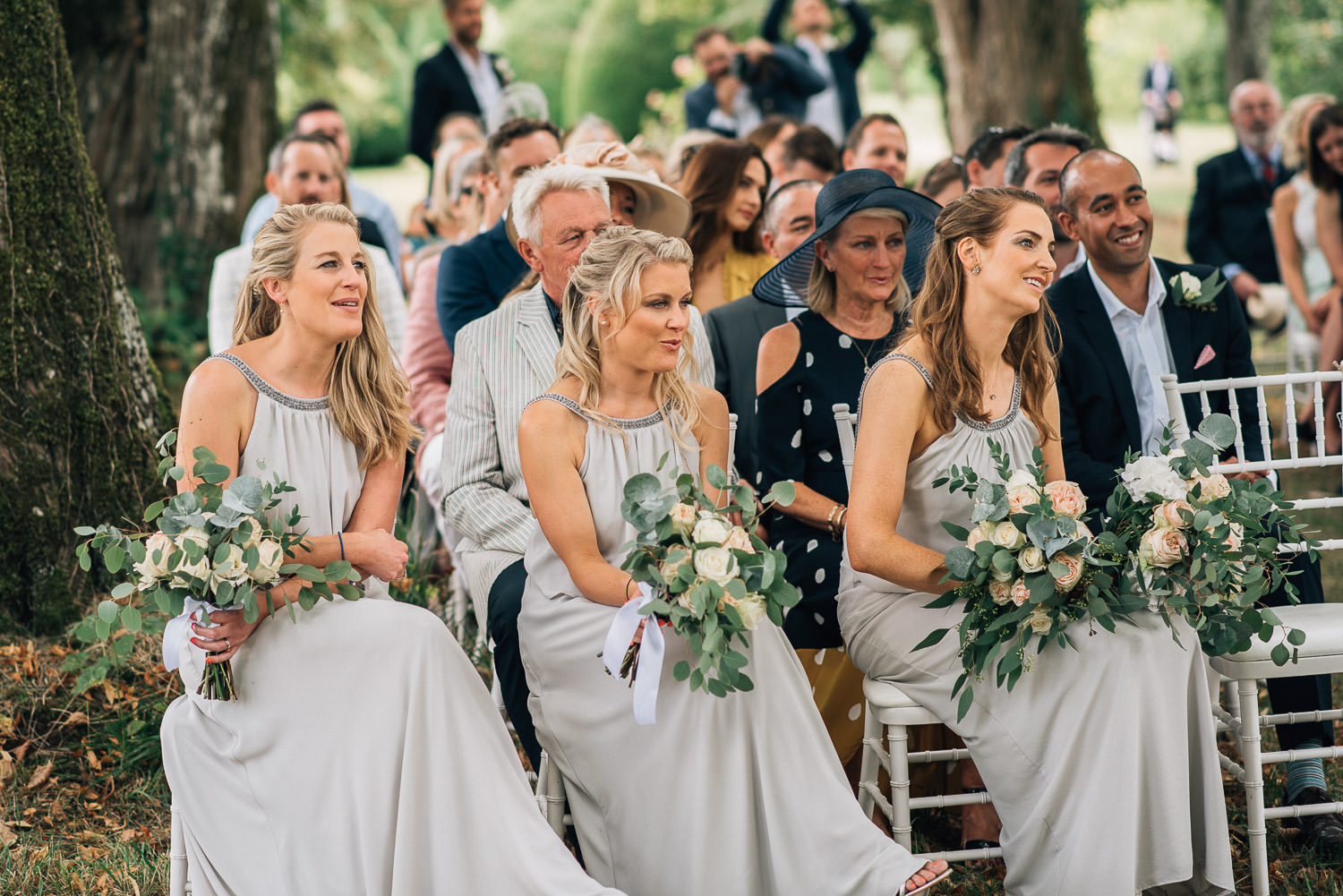 Bridesmaids smiling in outdoor wedding at chateau de la bourlie wedding by destination wedding photographer the shannons photography