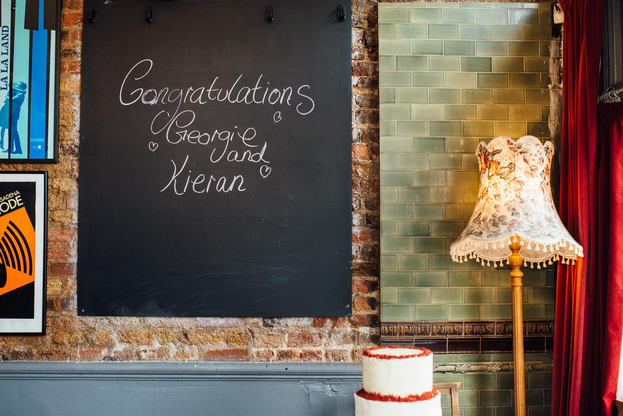 The londesborough pub wedding sign in stoke newington town hall wedding by creative and alternative london wedding photographer the shannons photography