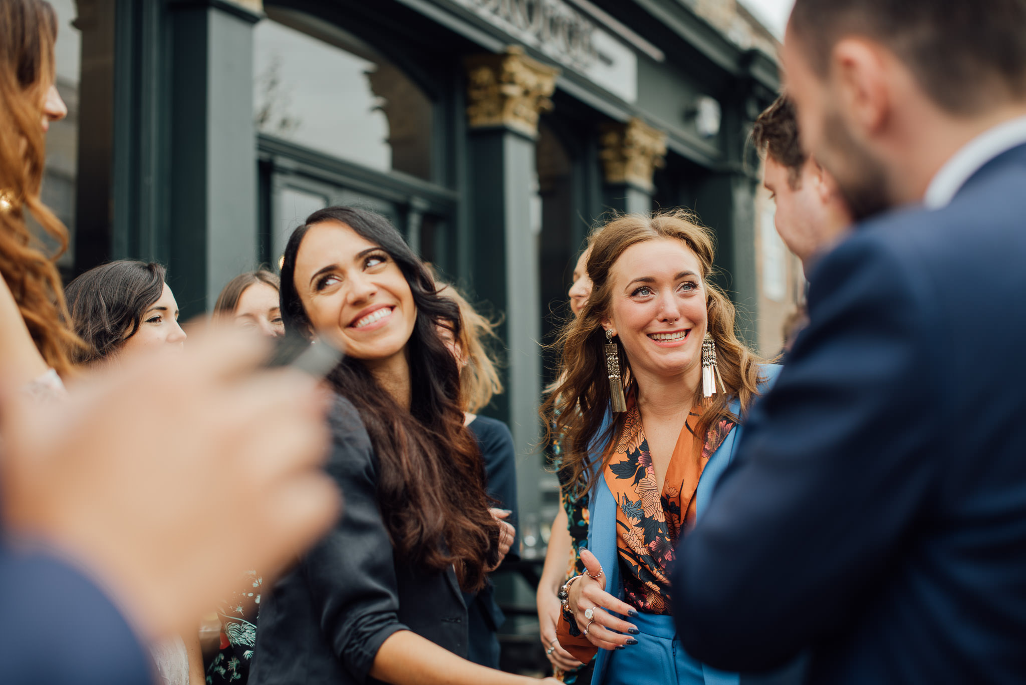 Guests drinking outside the londesborough pub in stoke newington town hall wedding by creative and alternative london wedding photographer the shannons photography