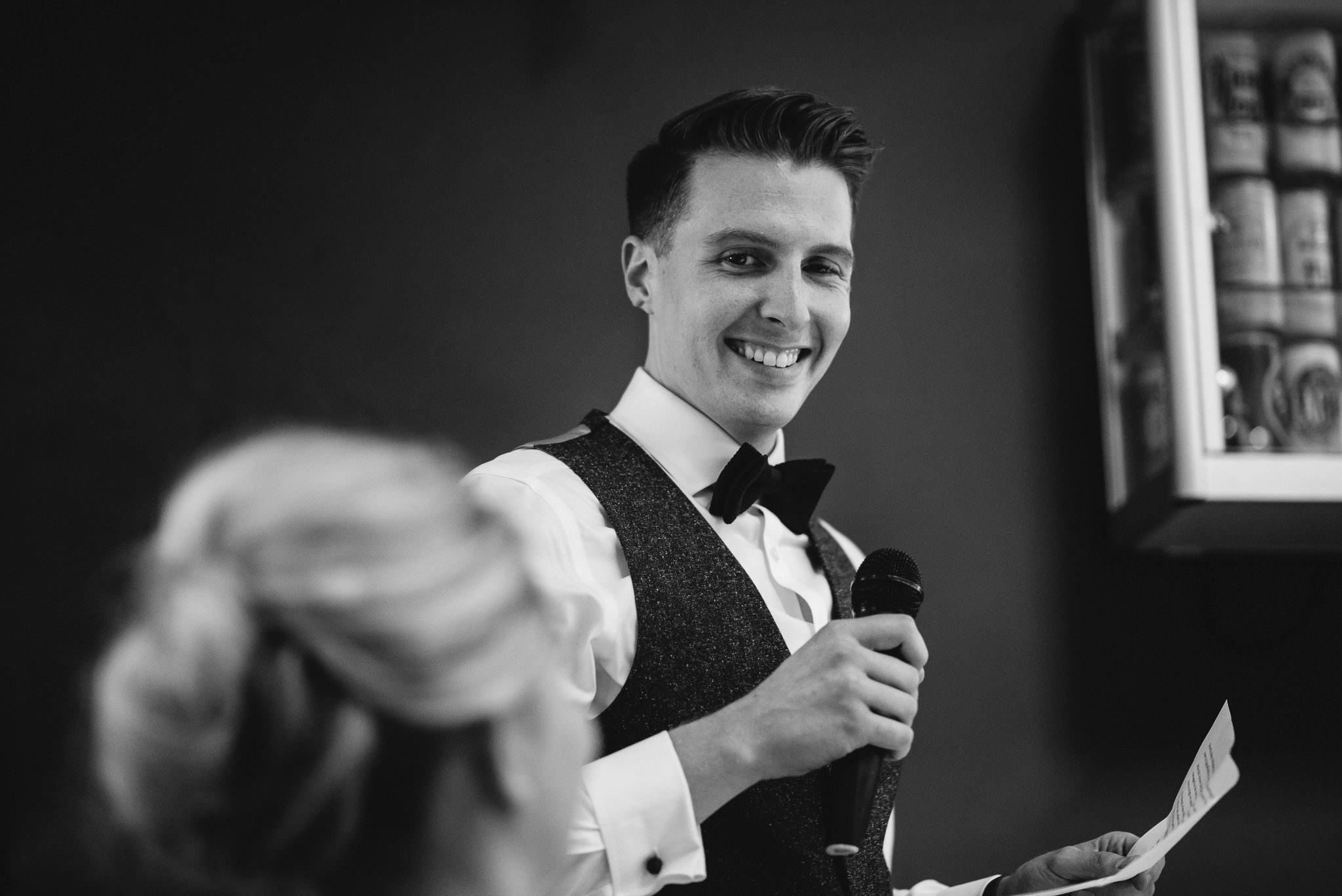 Groom laughing at bride in stoke newington town hall wedding by creative and alternative london wedding photographer the shannons photography