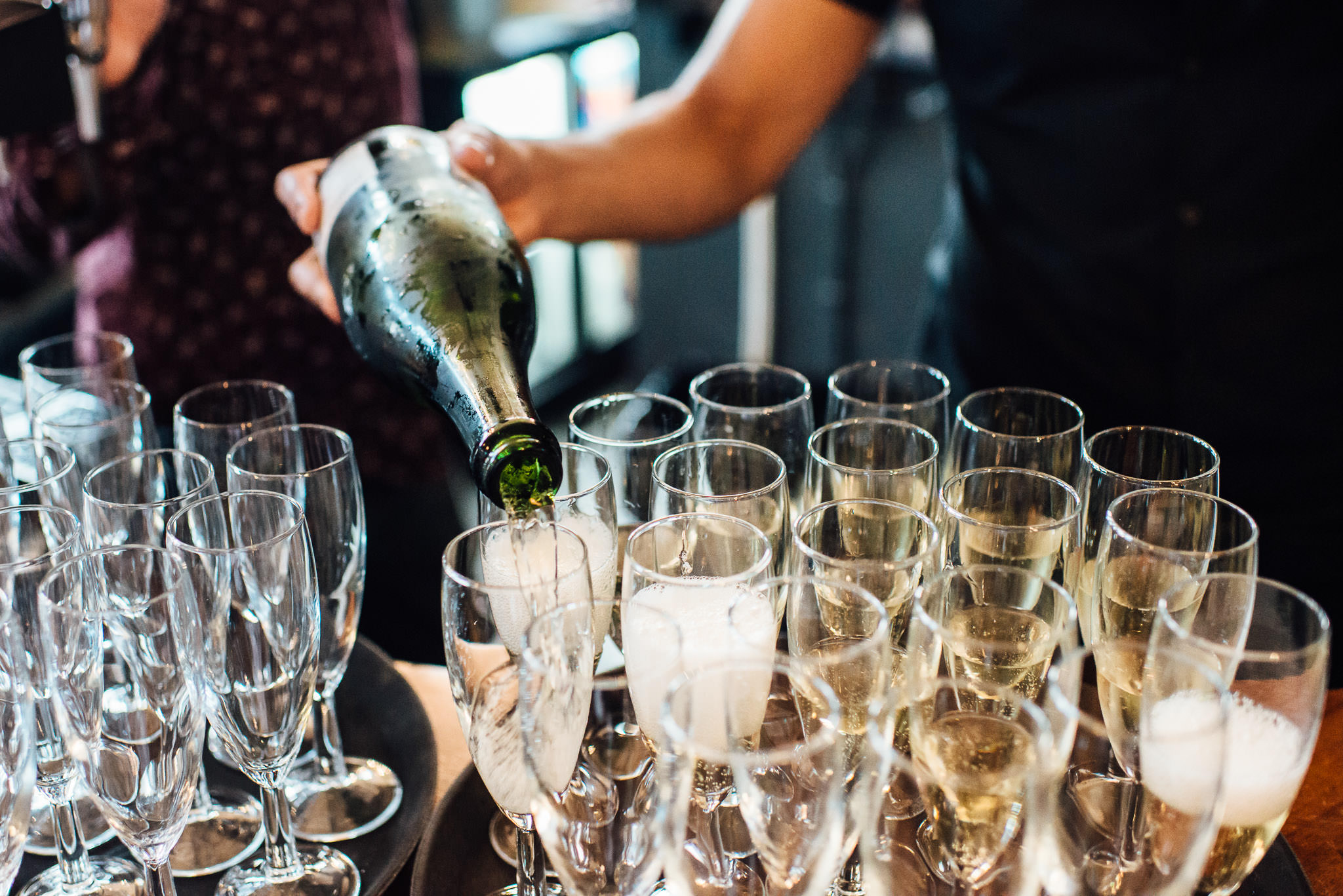 Champagne reception in the londesborough pub in stoke newington town hall wedding by creative and alternative london wedding photographer the shannons photography