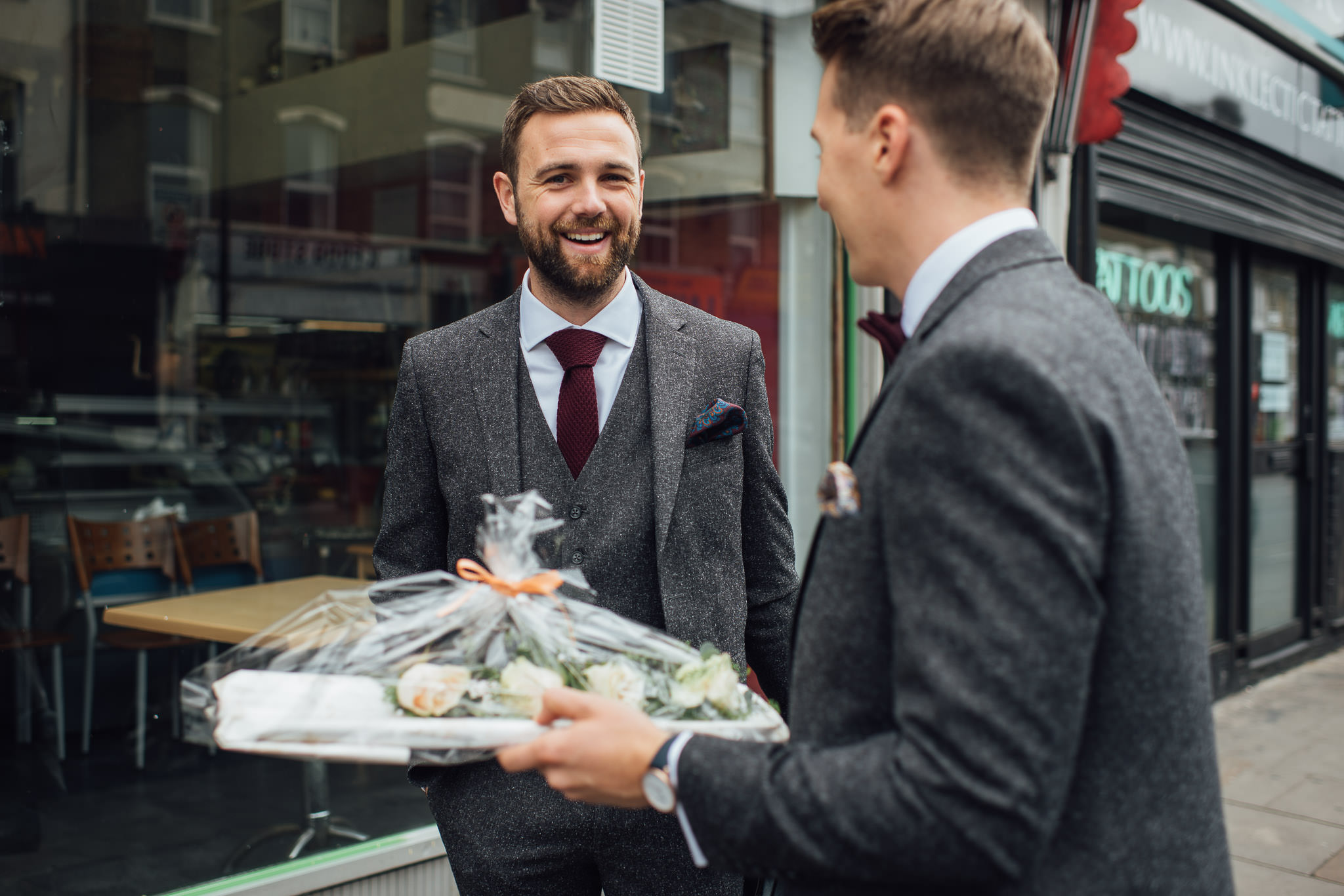 Groom in tweed suit in stoke newington town hall wedding by creative and alternative london wedding photographer the shannons photography