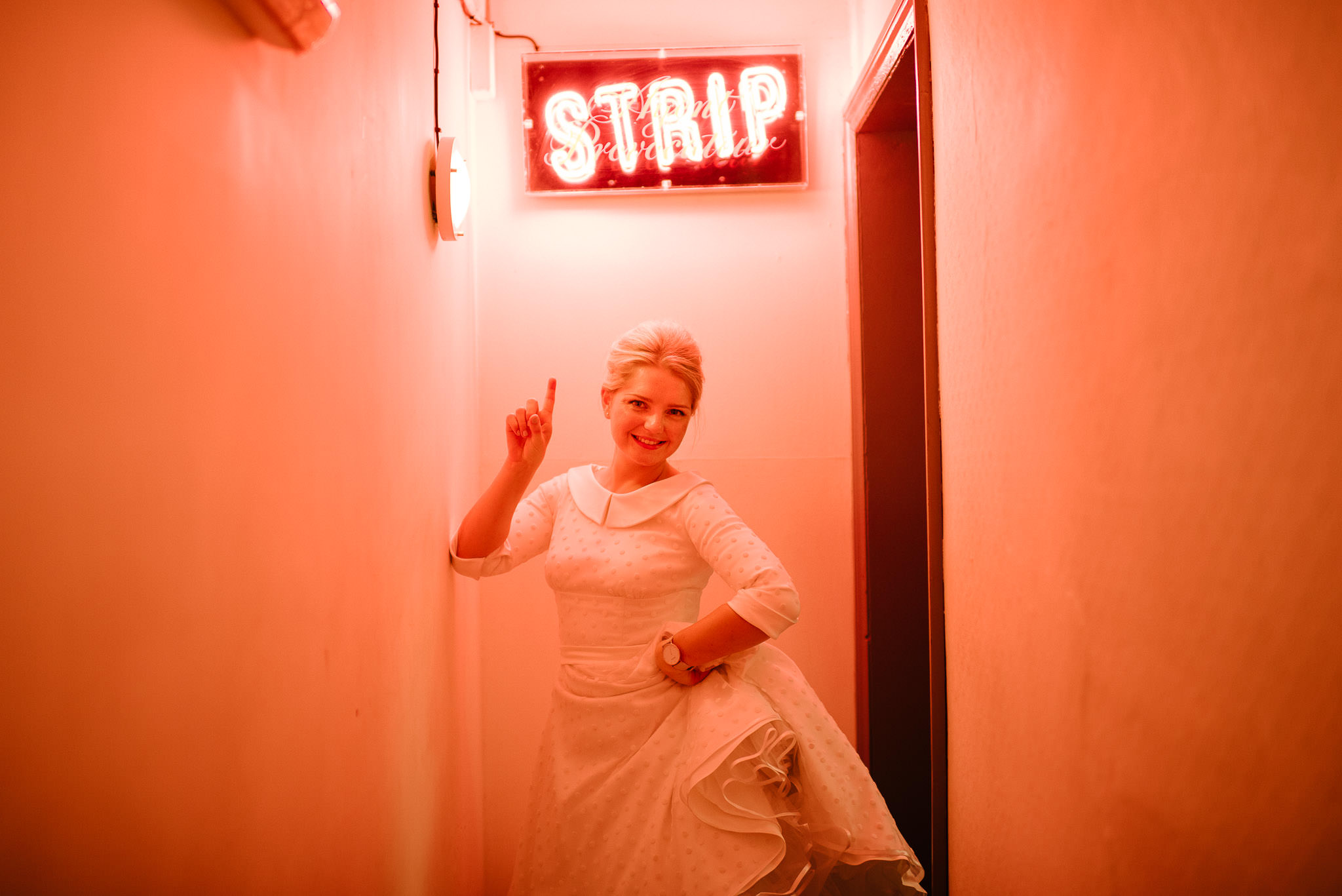 Funny bride posing in the londesborough pub in stoke newington town hall wedding by creative and alternative london wedding photographer the shannons photography