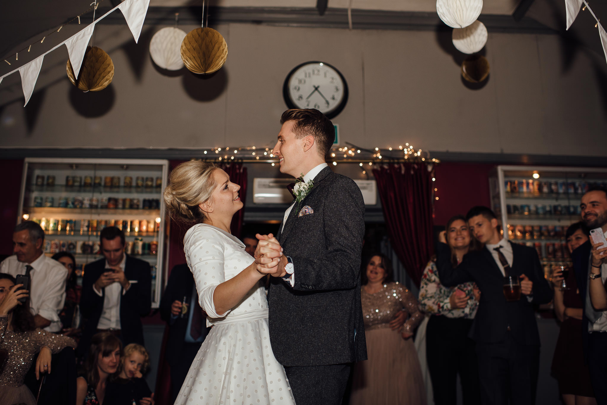 Bride and groom dancing in Londesborough pub in stoke newington town hall wedding by creative and alternative london wedding photographer the shannons photography