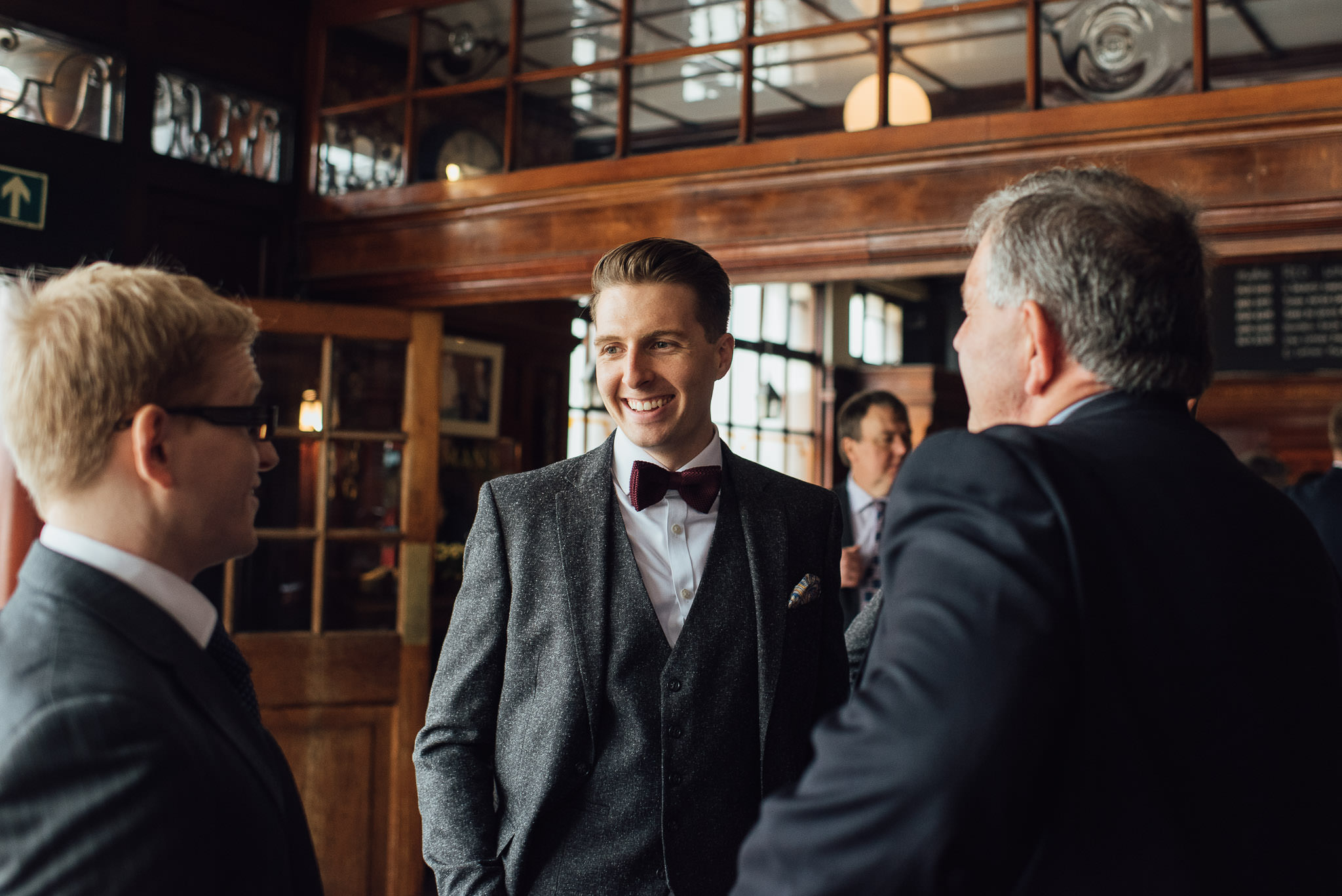 Groom getting ready in the rose and crown stoke newington in stoke newington town hall wedding by creative and alternative london wedding photographer the shannons photography
