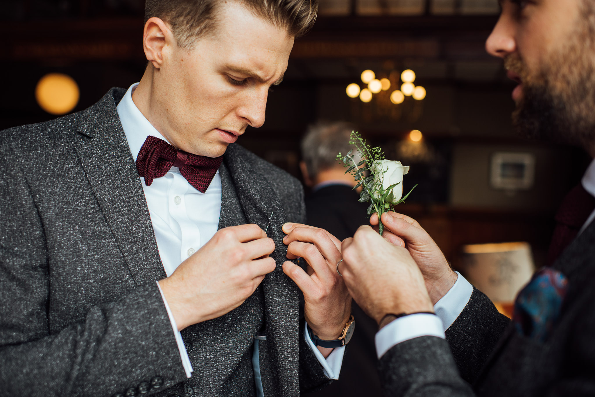 Groom in rose and crown pub in stoke newington town hall wedding by creative and alternative london wedding photographer the shannons photography