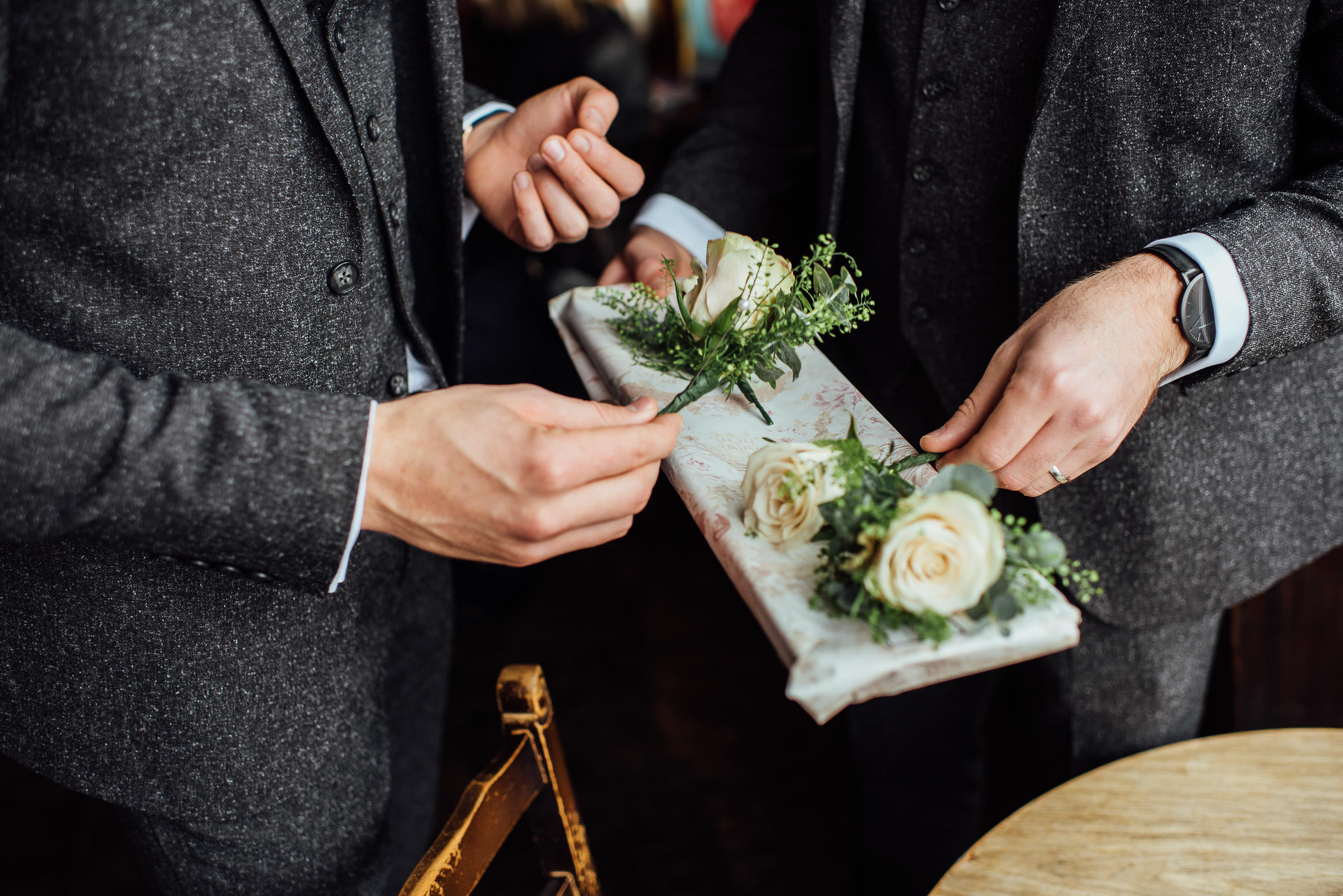 Groom button hole in stoke newington town hall wedding by creative and alternative london wedding photographer the shannons photography