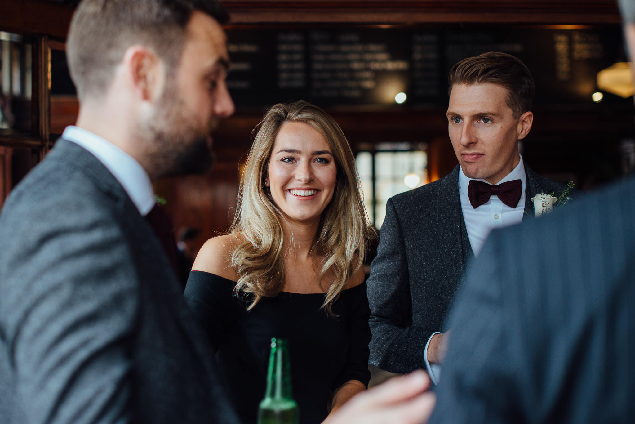 Wedding guests in the rose and crown in stoke newington town hall wedding by creative and alternative london wedding photographer the shannons photography