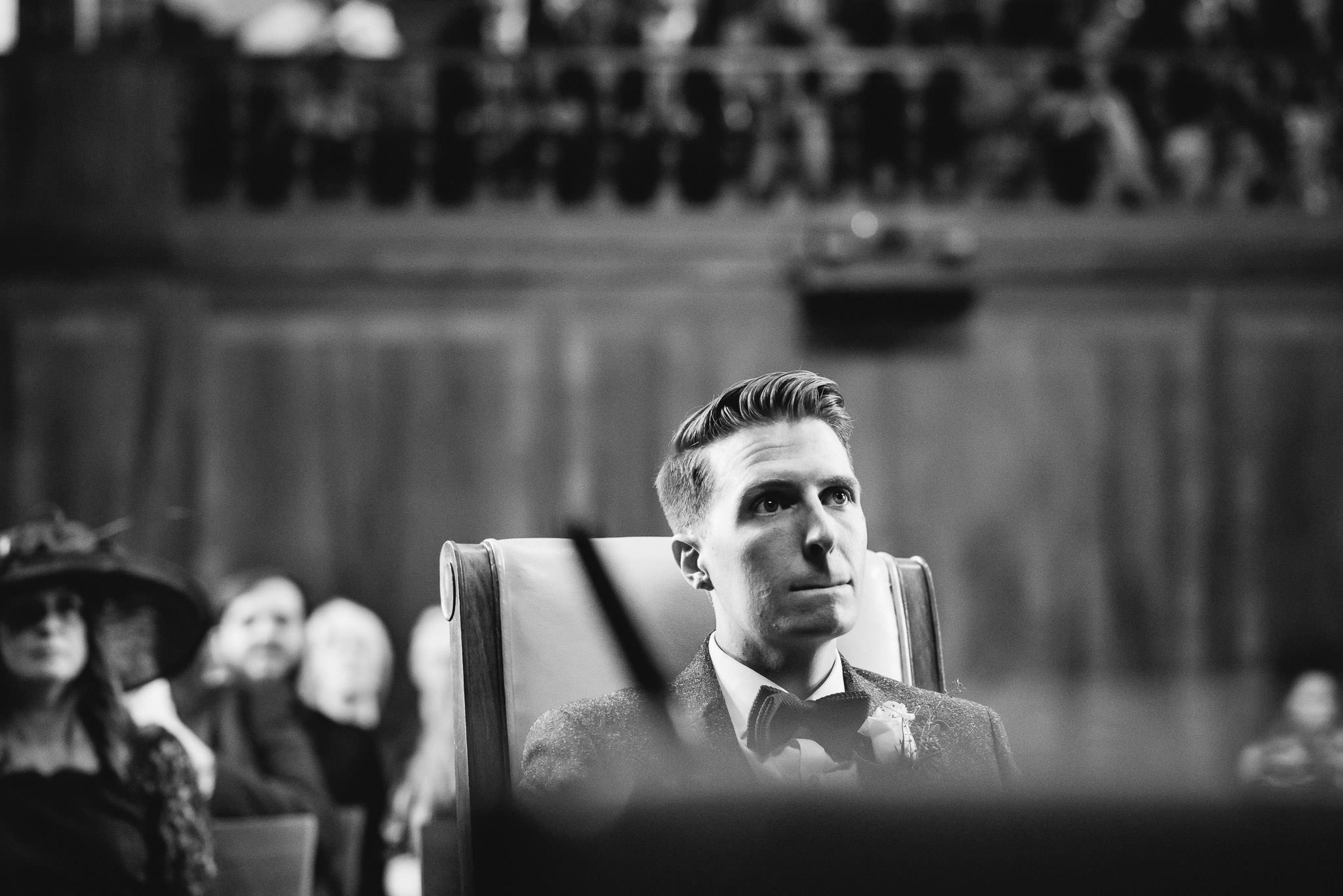 Anxious groom in stoke newington town hall wedding by creative and alternative london wedding photographer the shannons photography