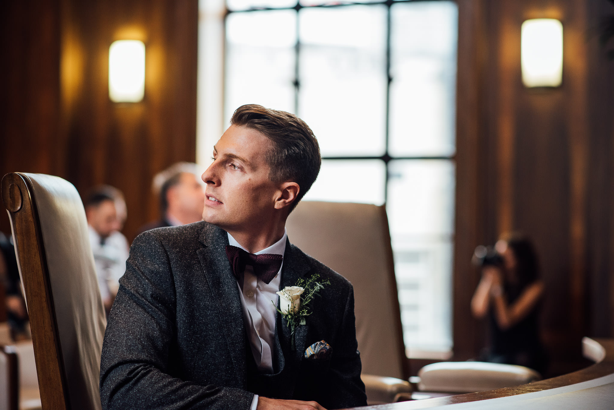 Groom looking at bride in stoke newington town hall wedding by creative and alternative london wedding photographer the shannons photography