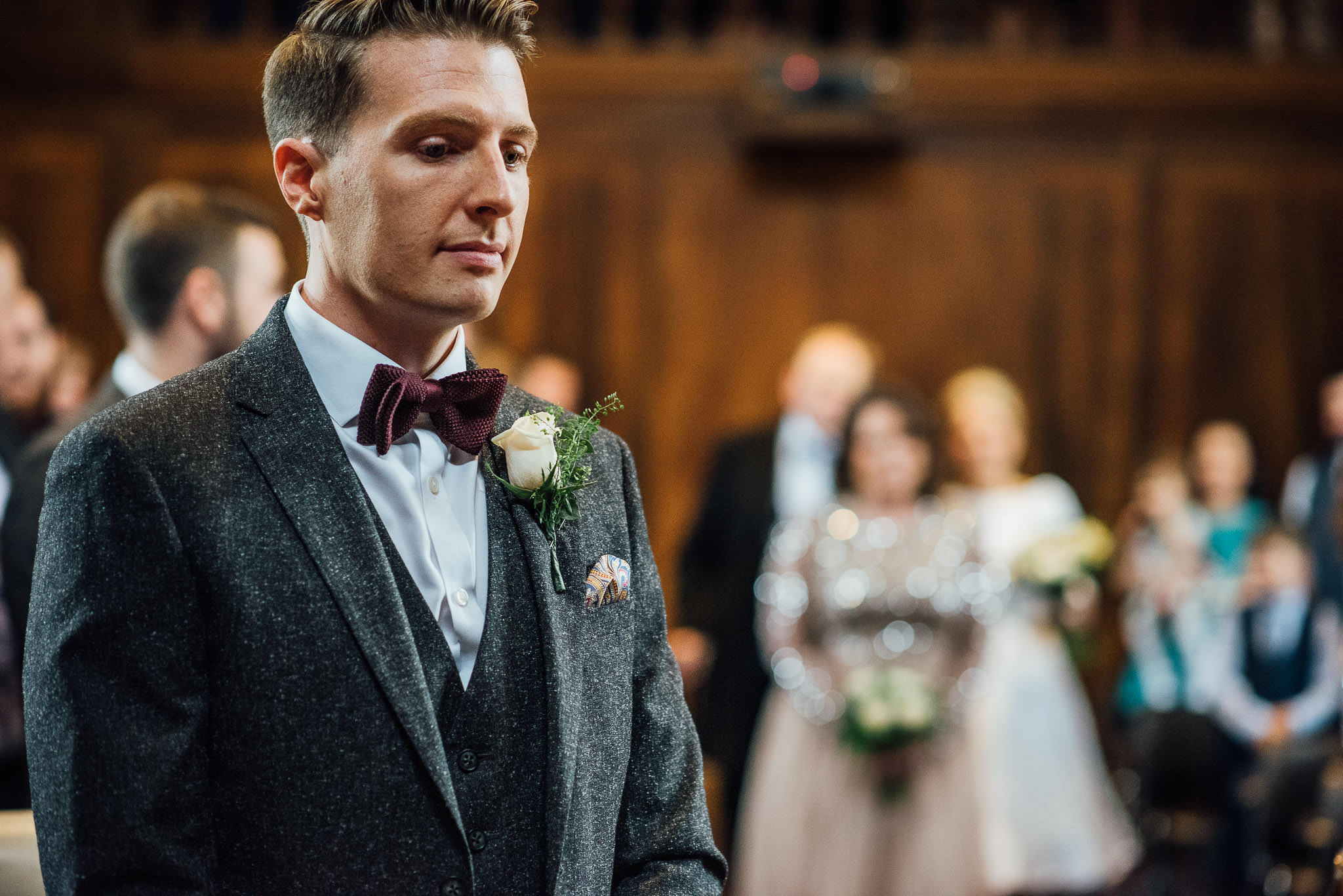 Bride walking down aisle in stoke newington town hall wedding by creative and alternative london wedding photographer the shannons photography