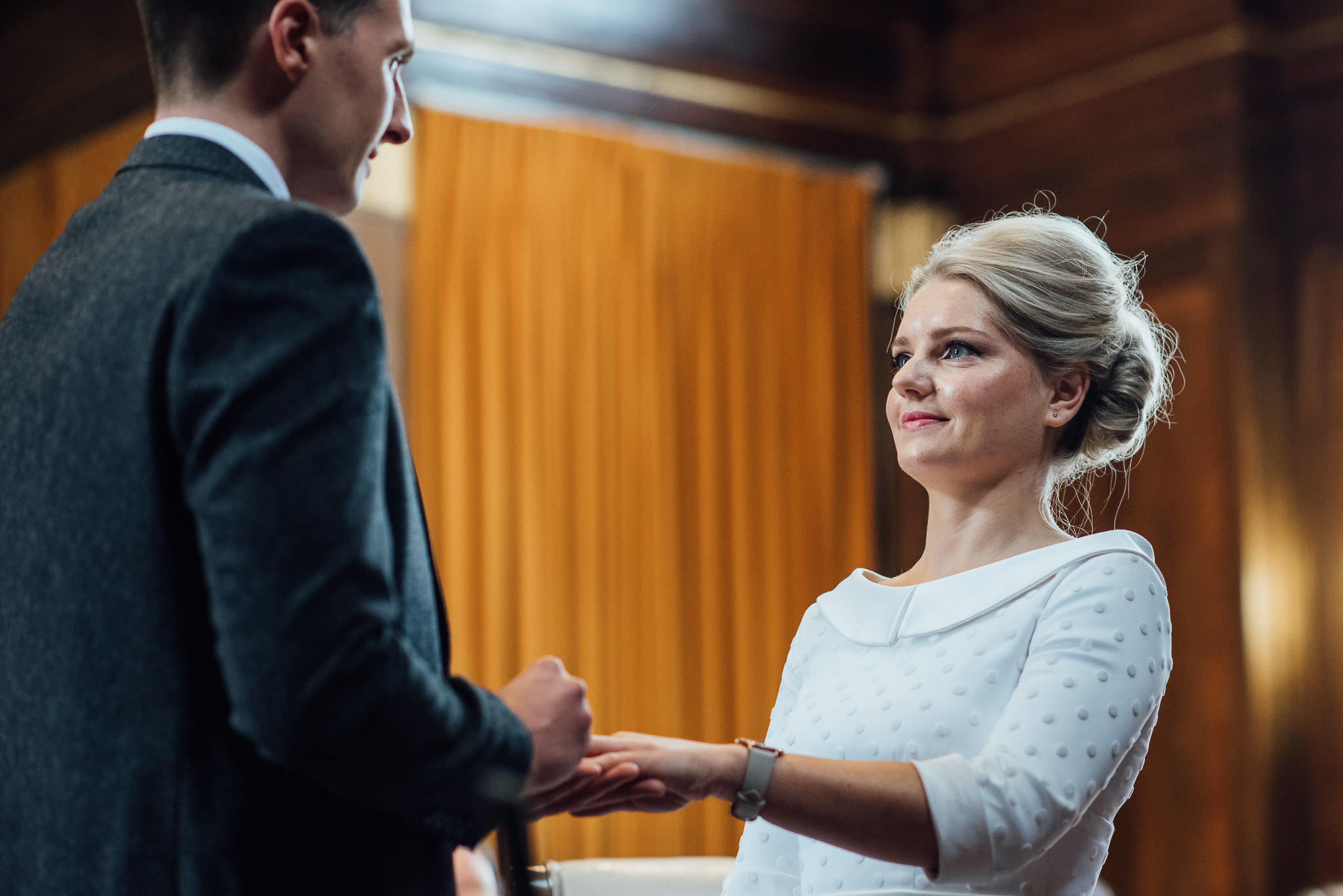 Bride looking at groom in stoke newington town hall wedding by creative and alternative london wedding photographer the shannons photography