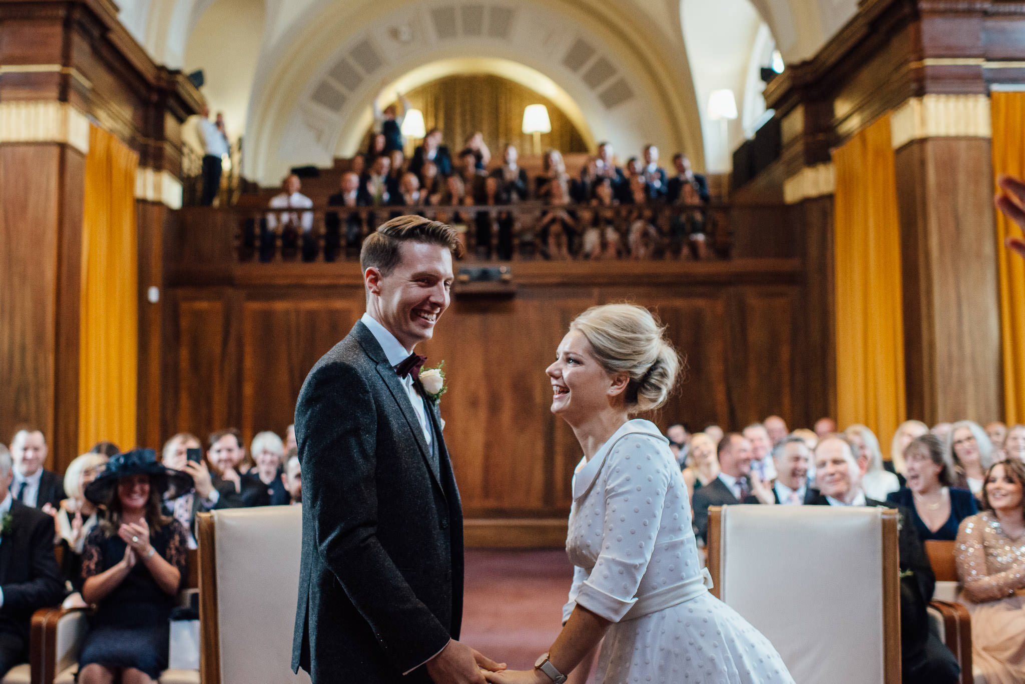 Couple Laughing in stoke newington town hall wedding by creative and alternative london wedding photographer the shannons photography