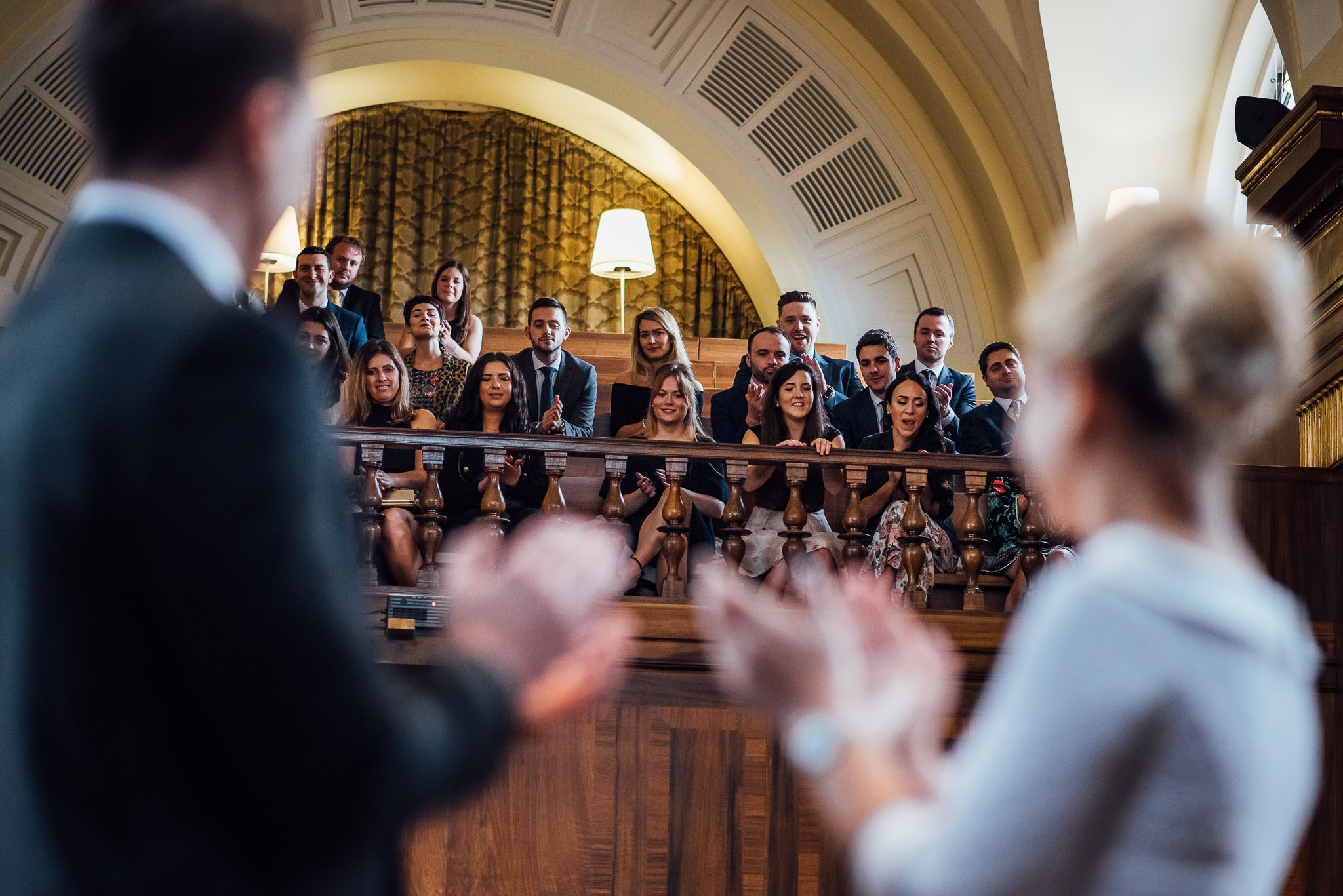 Congregation in stoke newington town hall wedding by creative and alternative london wedding photographer the shannons photography