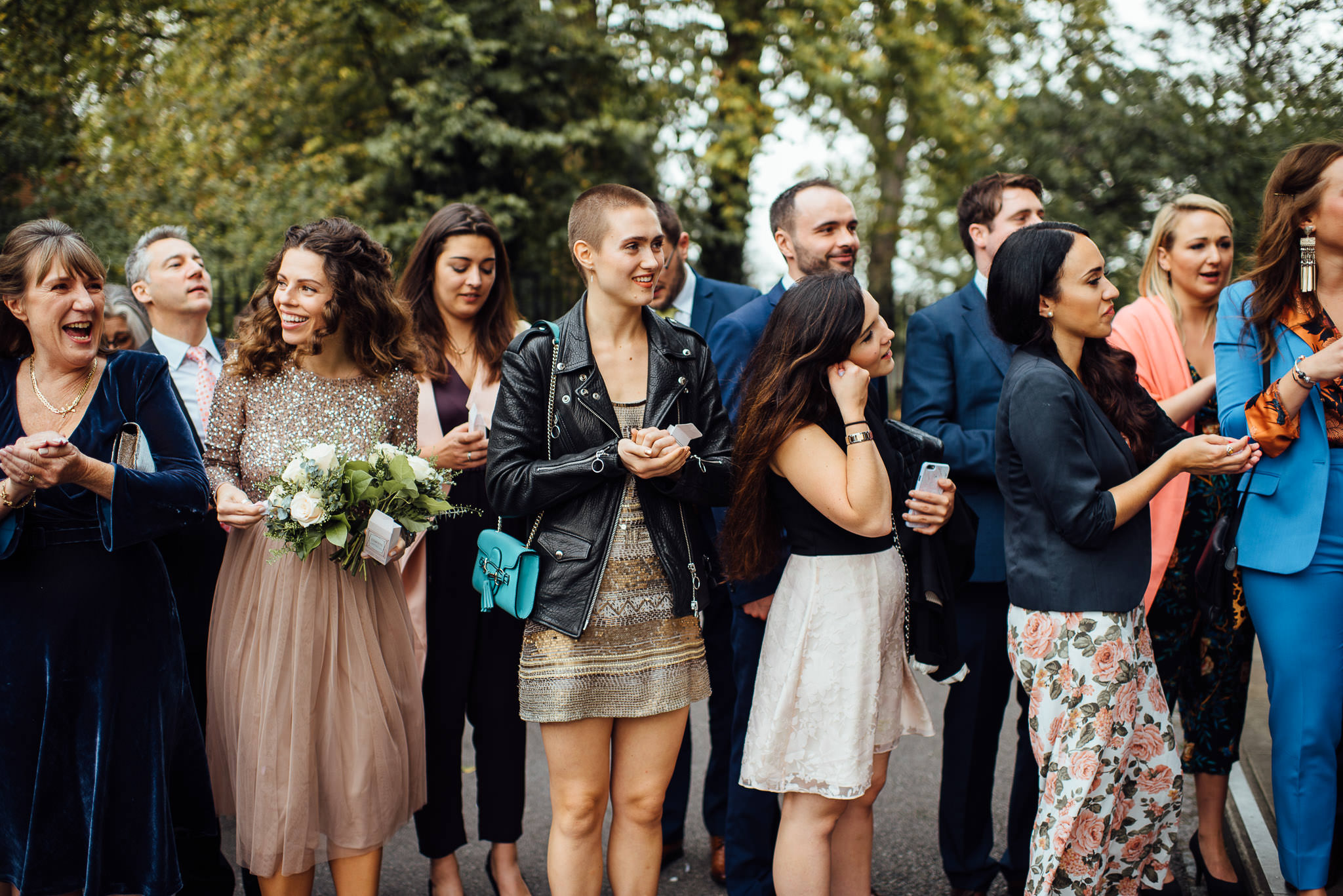 Confetti throw outside stoke newington town hall in stoke newington town hall wedding by creative and alternative london wedding photographer the shannons photography