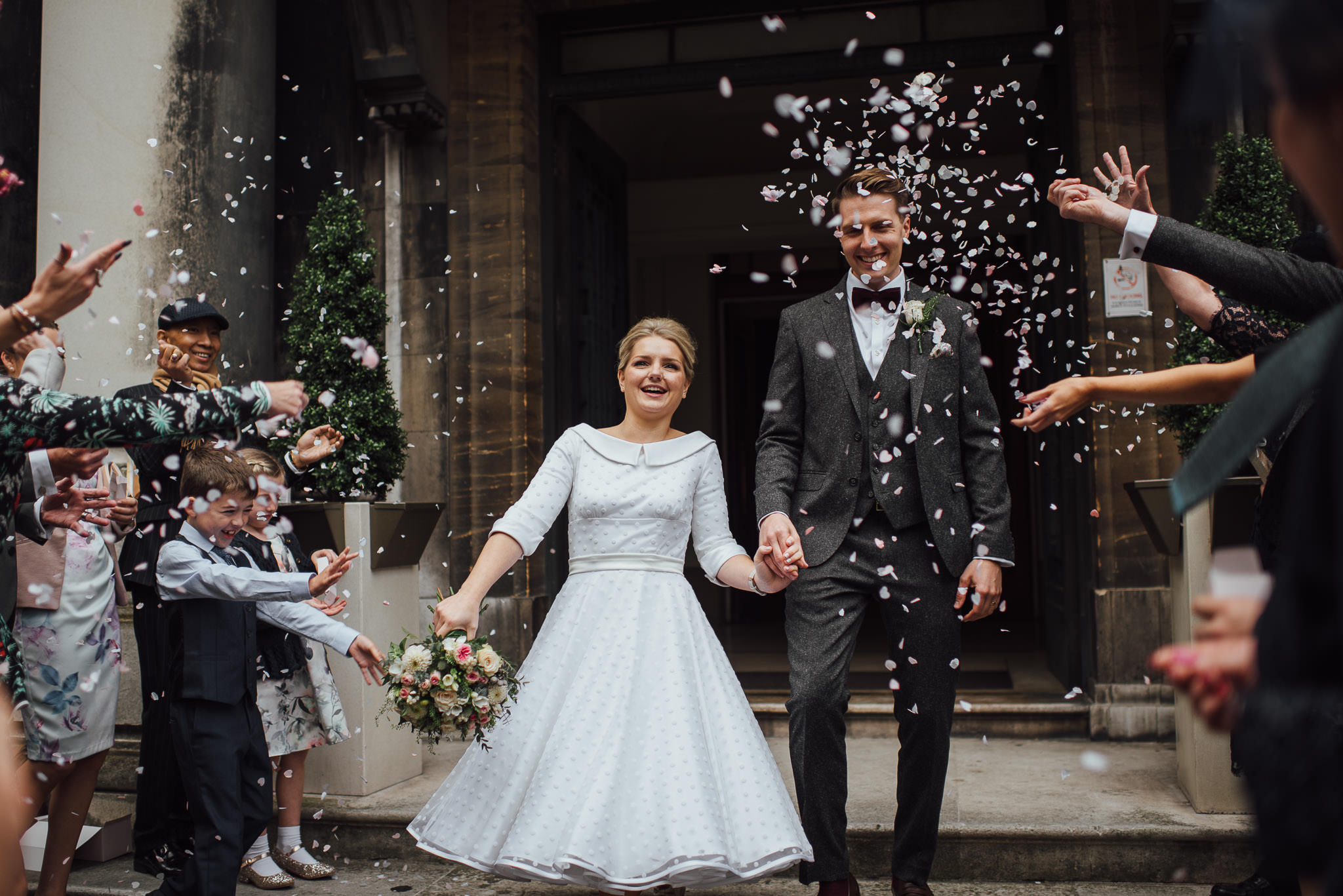Confetti throwing in stoke newington town hall wedding by creative and alternative london wedding photographer the shannons photography