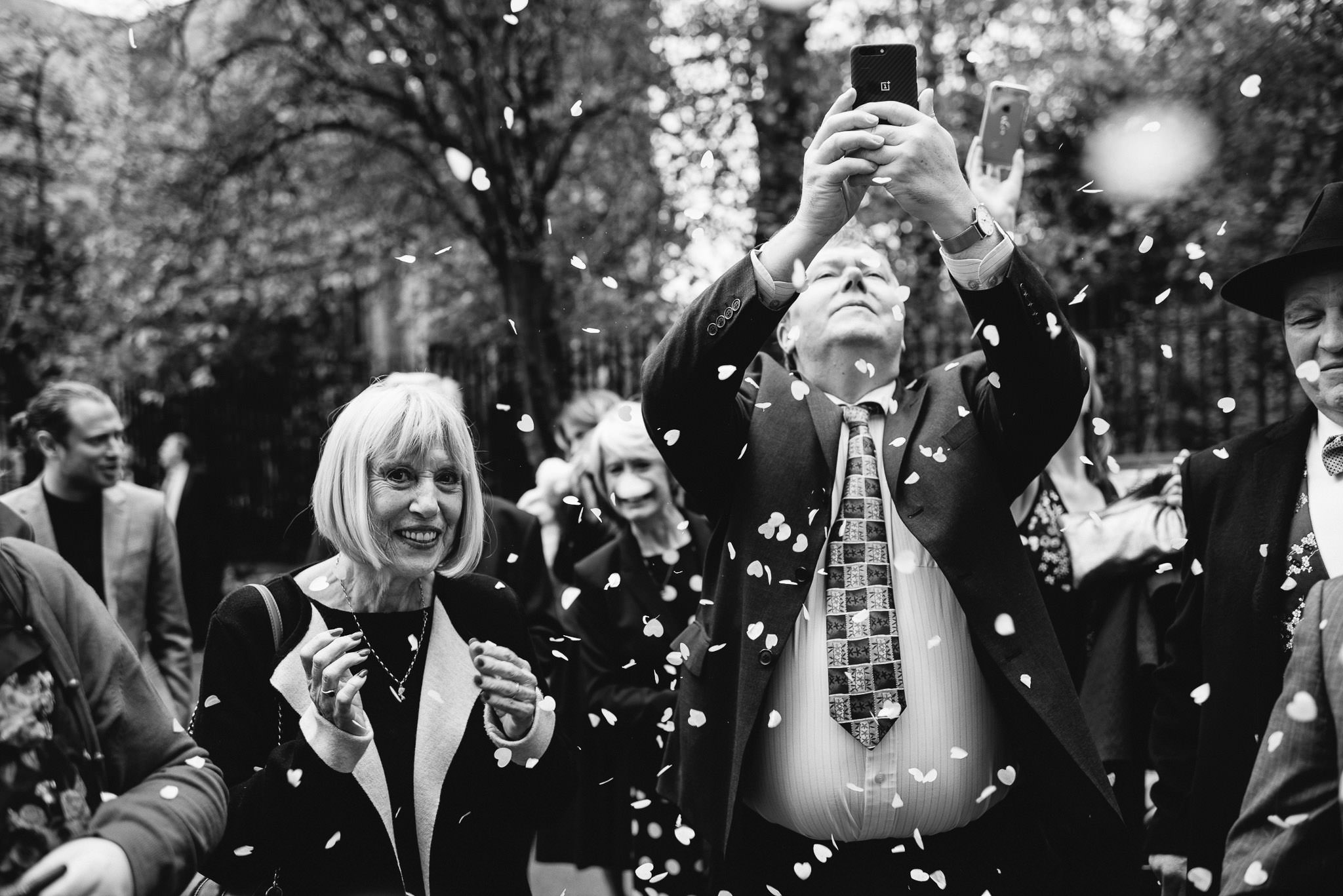 Guests outside in stoke newington town hall wedding by creative and alternative london wedding photographer the shannons photography