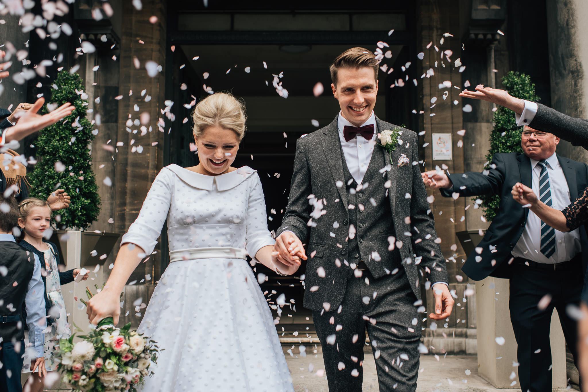 Confetti thrown over couple in stoke newington town hall wedding by creative and alternative london wedding photographer the shannons photography
