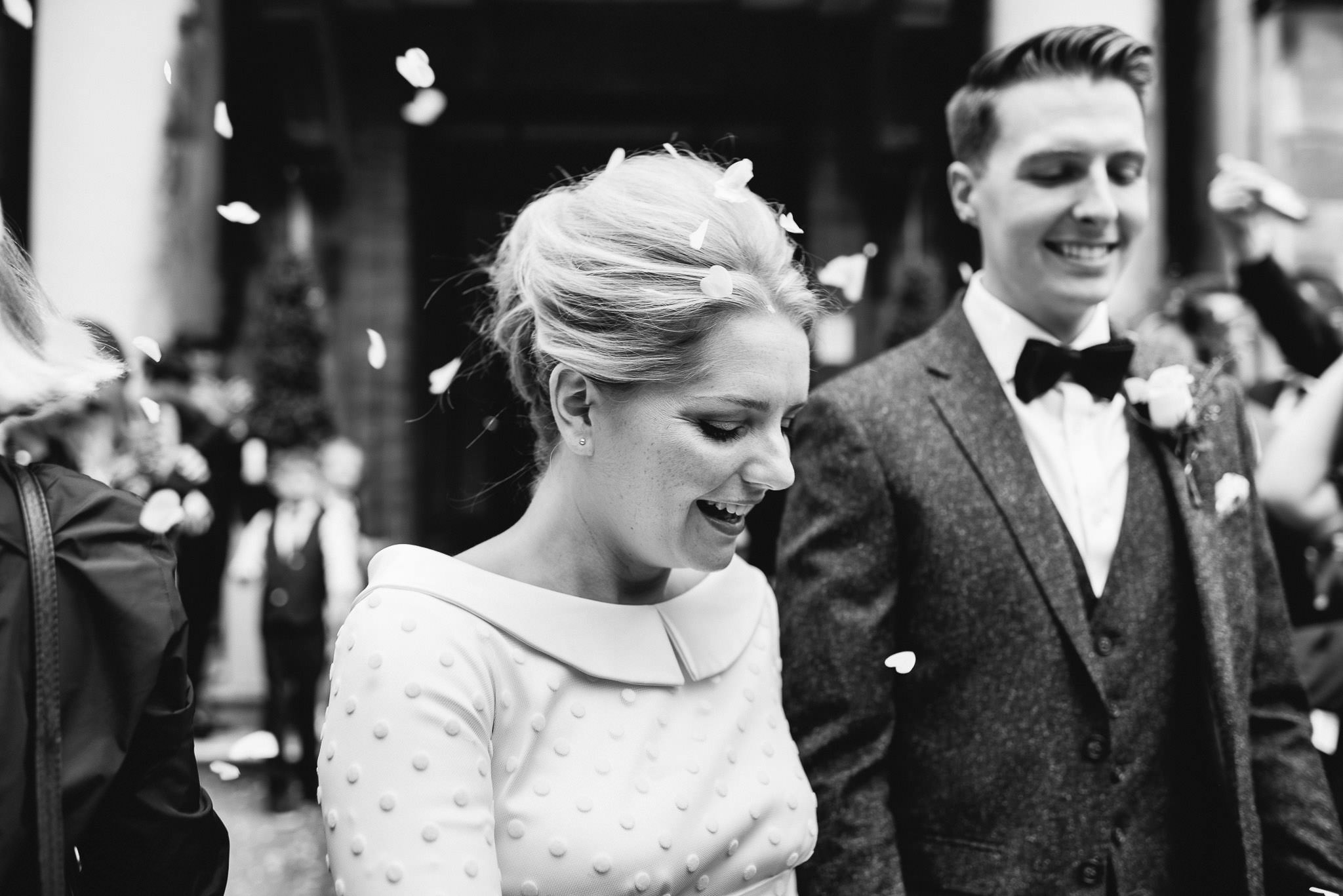 Smiling bride outside stoke newington town hall in stoke newington town hall wedding by creative and alternative london wedding photographer the shannons photography