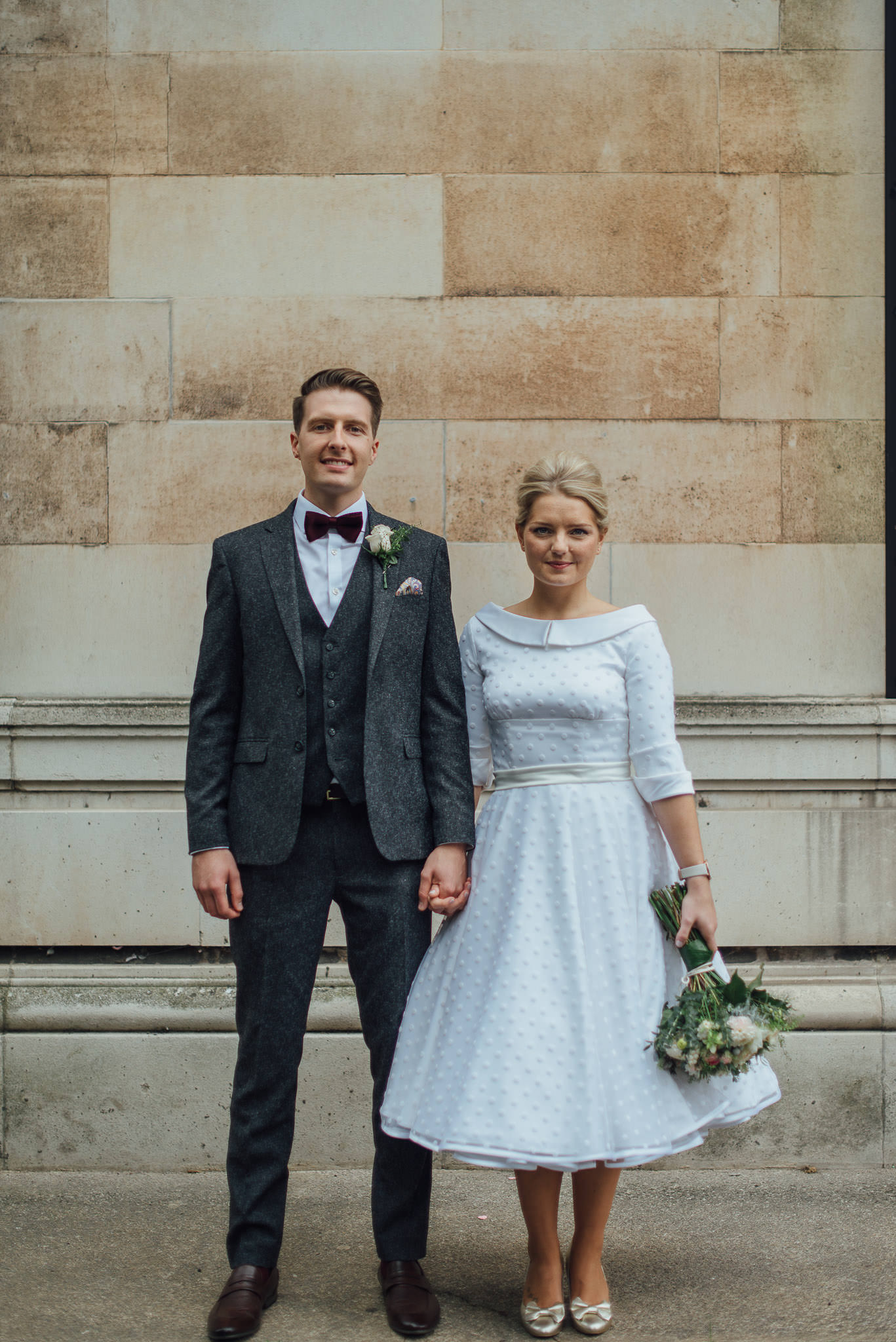 Couples portraits outside stoke newington town hall in stoke newington town hall wedding by creative and alternative london wedding photographer the shannons photography