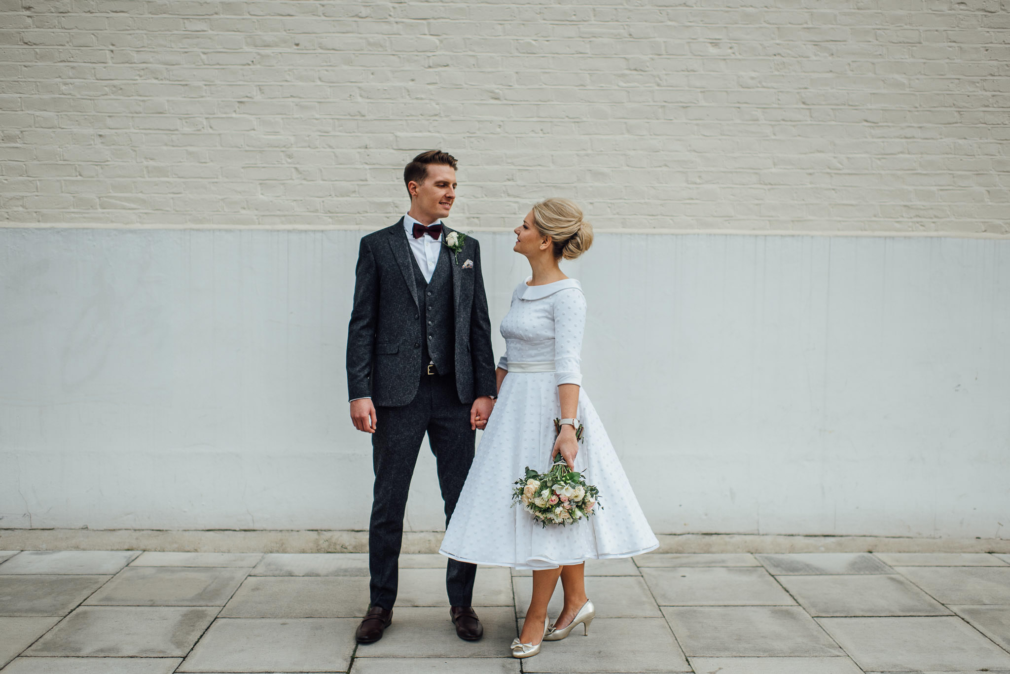 Cool bride and groom outside londesborough pub in stoke newington town hall wedding by creative and alternative london wedding photographer the shannons photography