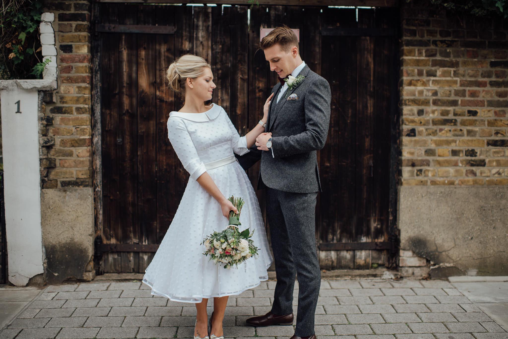 Stoke newington couple portrait outside the londesborough pub in stoke newington town hall wedding by creative and alternative london wedding photographer the shannons photography