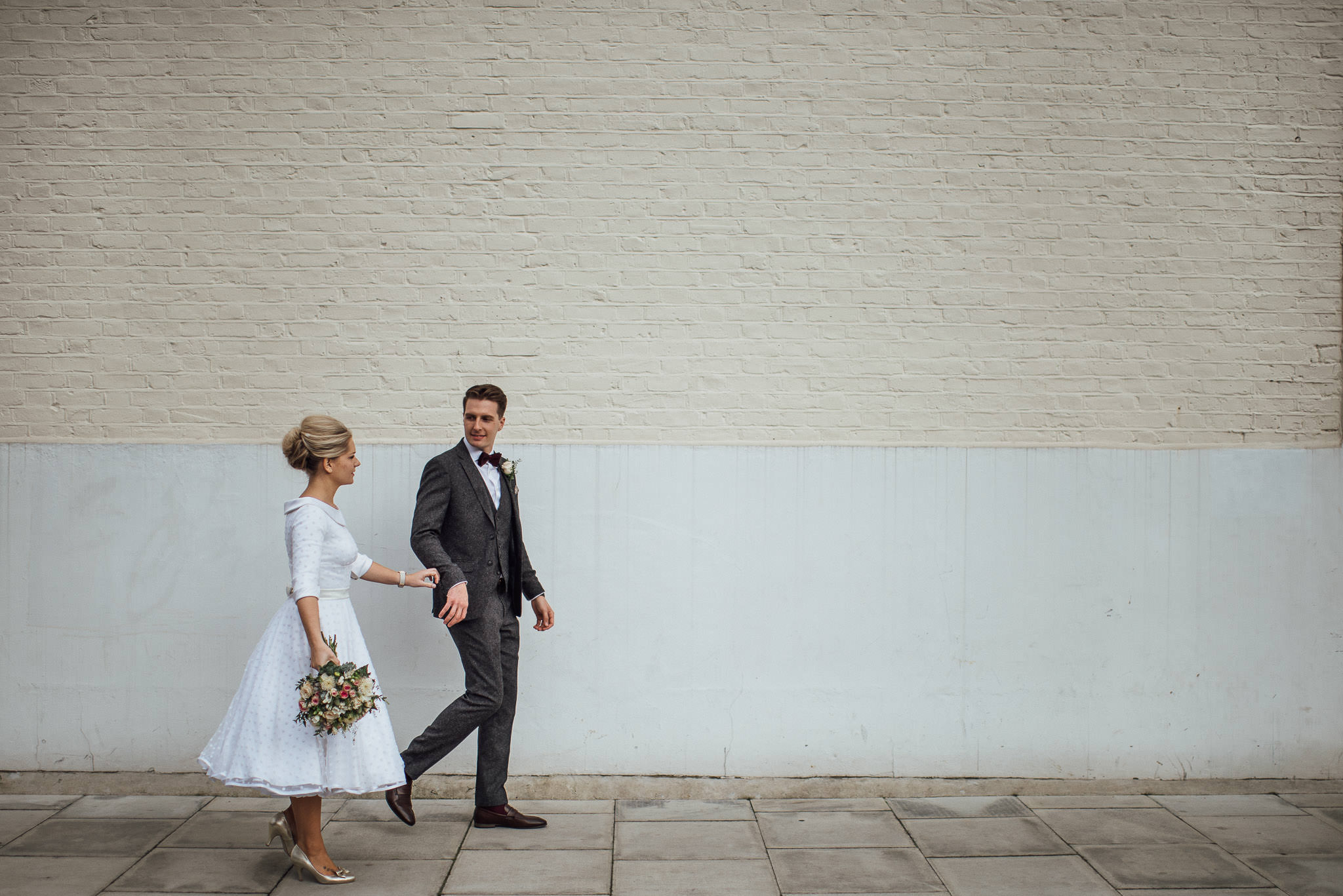 Bride and groom outside the londesborough pub in stoke newington town hall wedding by creative and alternative london wedding photographer the shannons photography