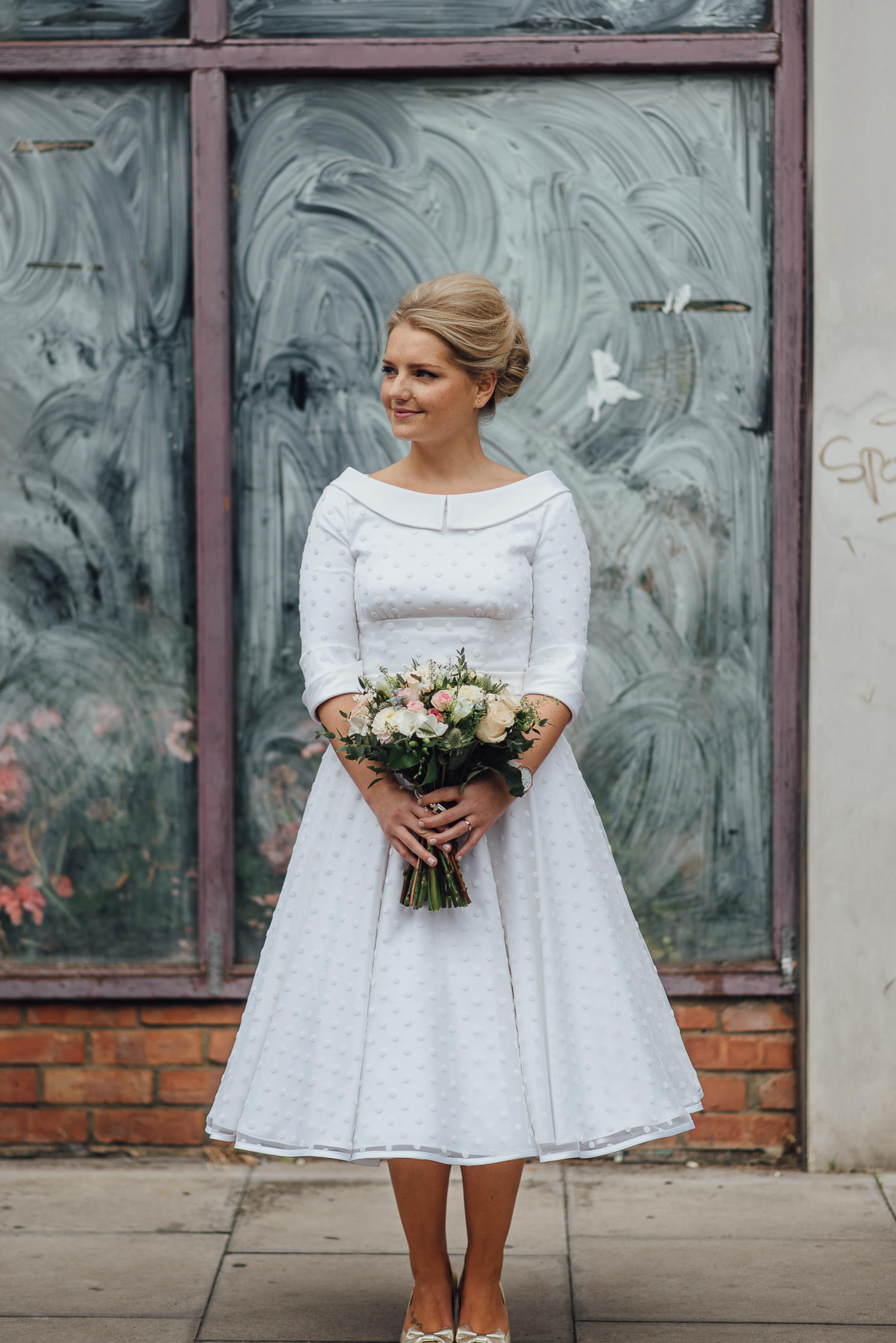 Bride in vintage tea dress in stoke newington town hall wedding by creative and alternative london wedding photographer the shannons photography