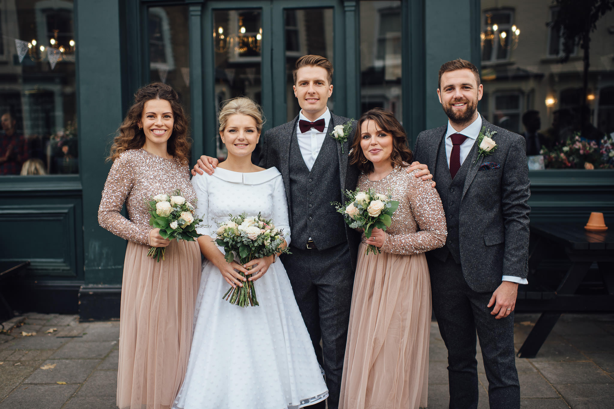 Bridal party outside londesborough pub in stoke newington town hall wedding by creative and alternative london wedding photographer the shannons photography