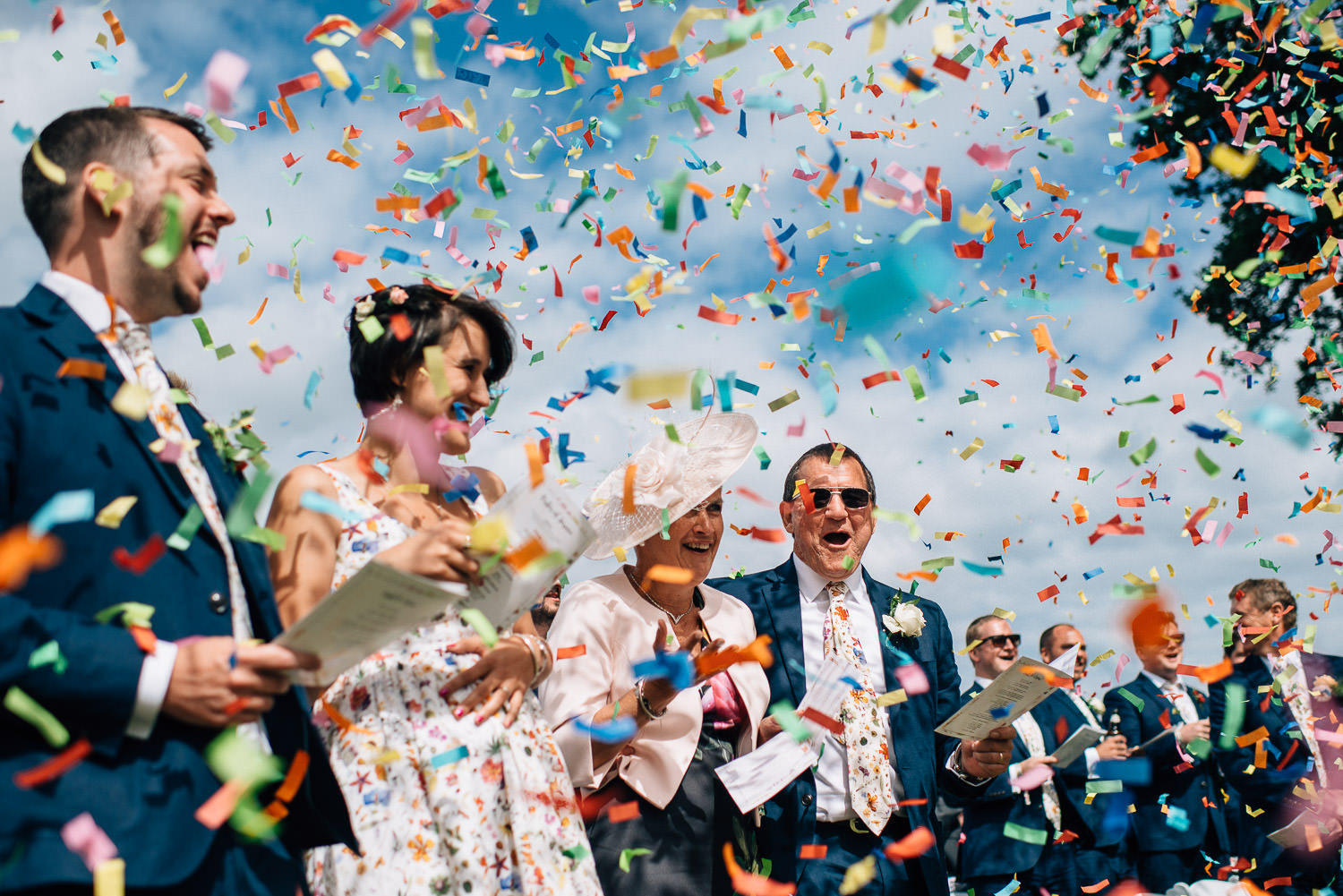 confetti canon at festival wedding by creative and alternative london wedding photographer the shannons photography